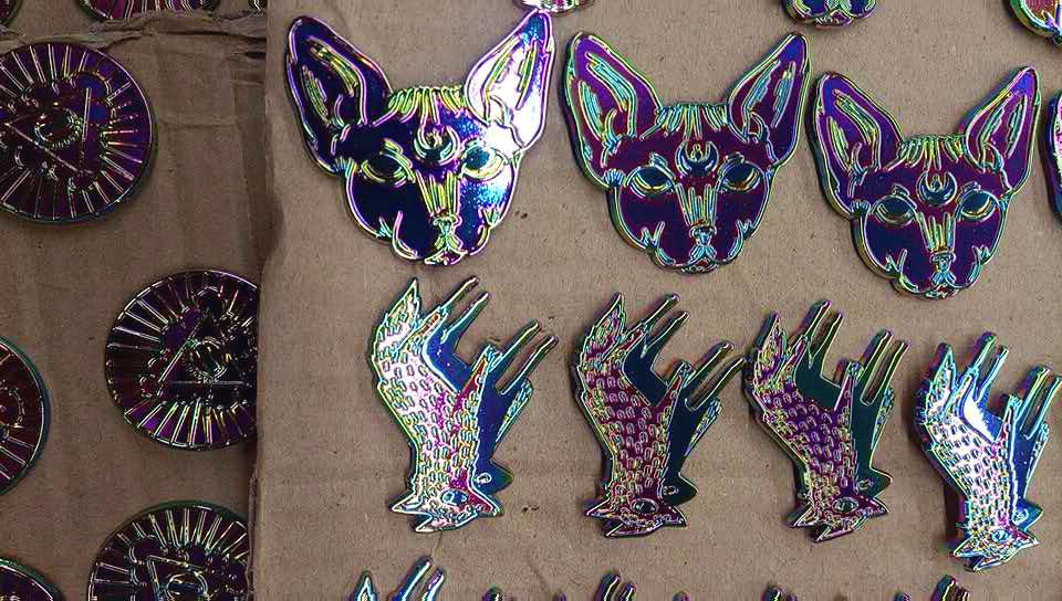 Soft enamel rainbow metal pins waiting for their enamel.