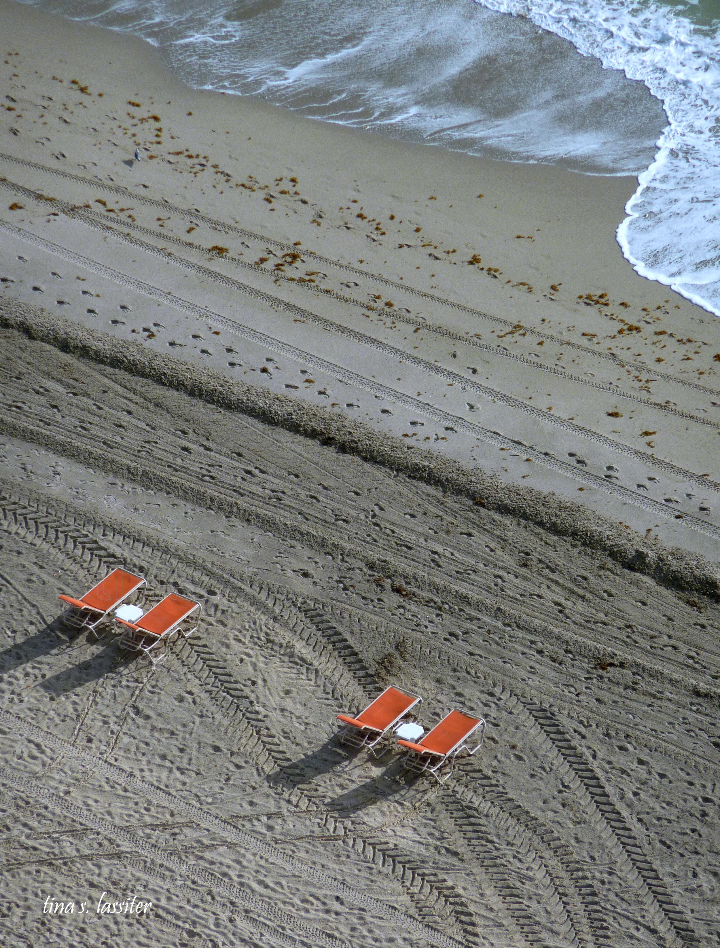 orange chairs on the beach