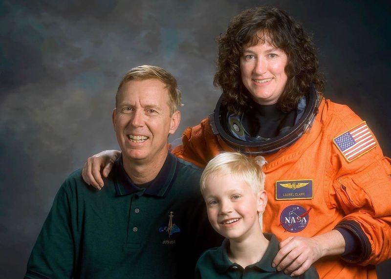 Dr. Jonathan Clark, Dr. Laurel Clark, and their son Iain.