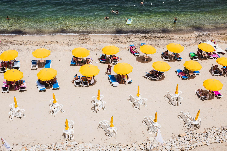 yellow umbrellas on a sicilian beach