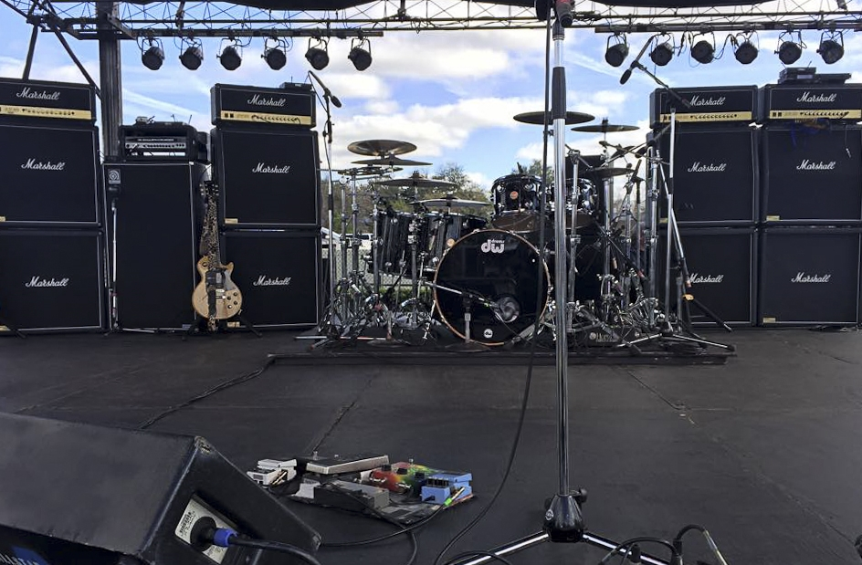 Guitar amplifier, bass amplifier and drum set up for outdoor festival