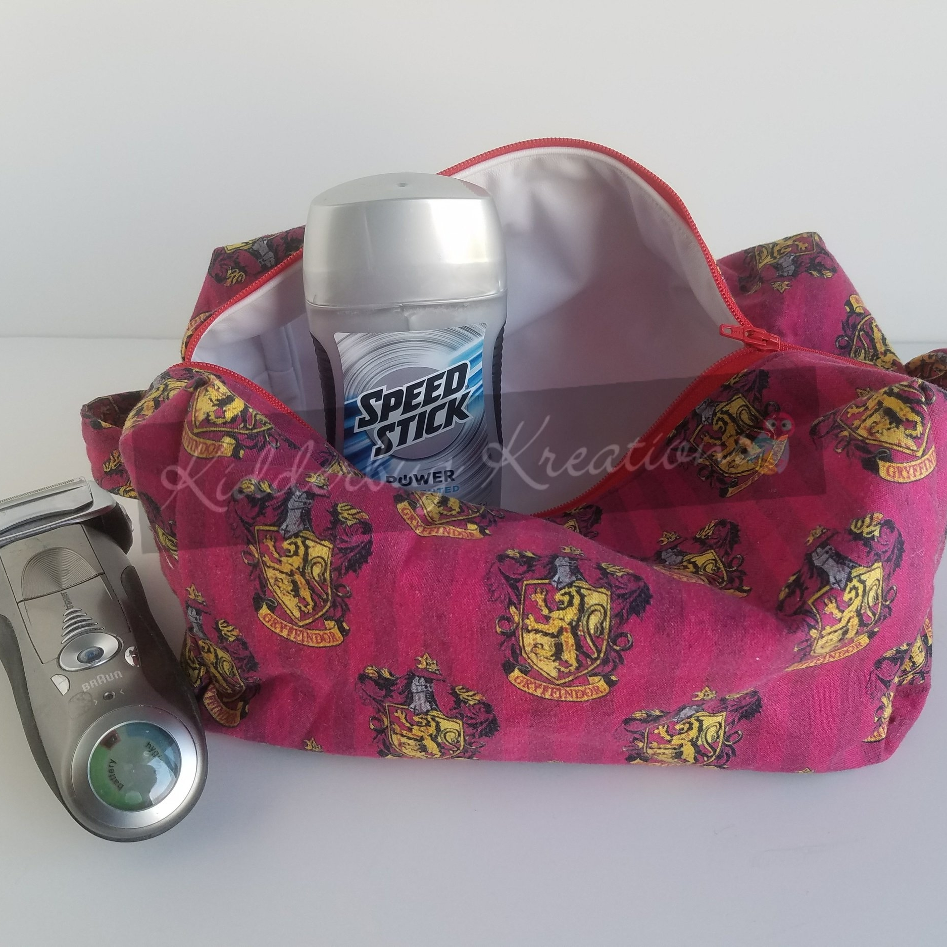 Harry Potter Gryffindor Fabric Dopp Bag - Even if you aren't traveling to the Ministry of Magic, you will love having a dopp bag with a waterproof lining for your toiletries the next time you travel. (Slytherin fabric available also)