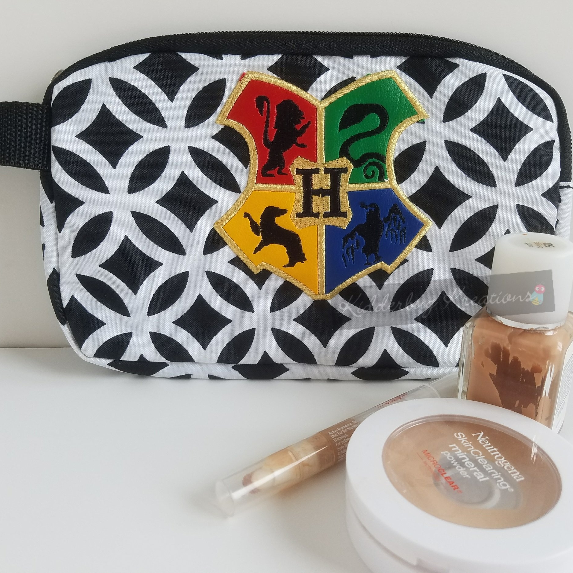 Cosmetic bag - Small enough to tuck your cosmetics safely in your travel bag yet cute enough to not have to hide it.