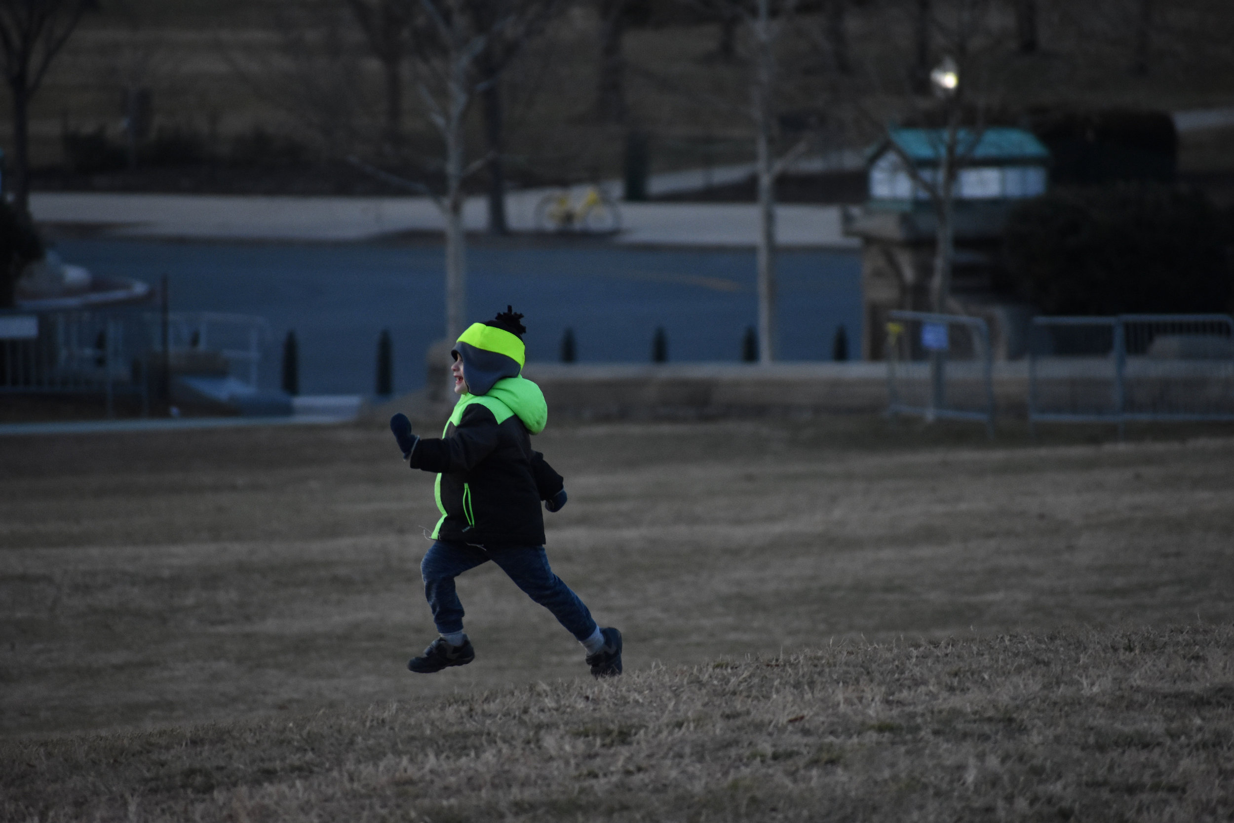 A boy dashes across the West Lawn of the U.S. Capitol in Washington just before sunset, Thursday, Jan. 25, 2018. (Lindsey Leake/American University)