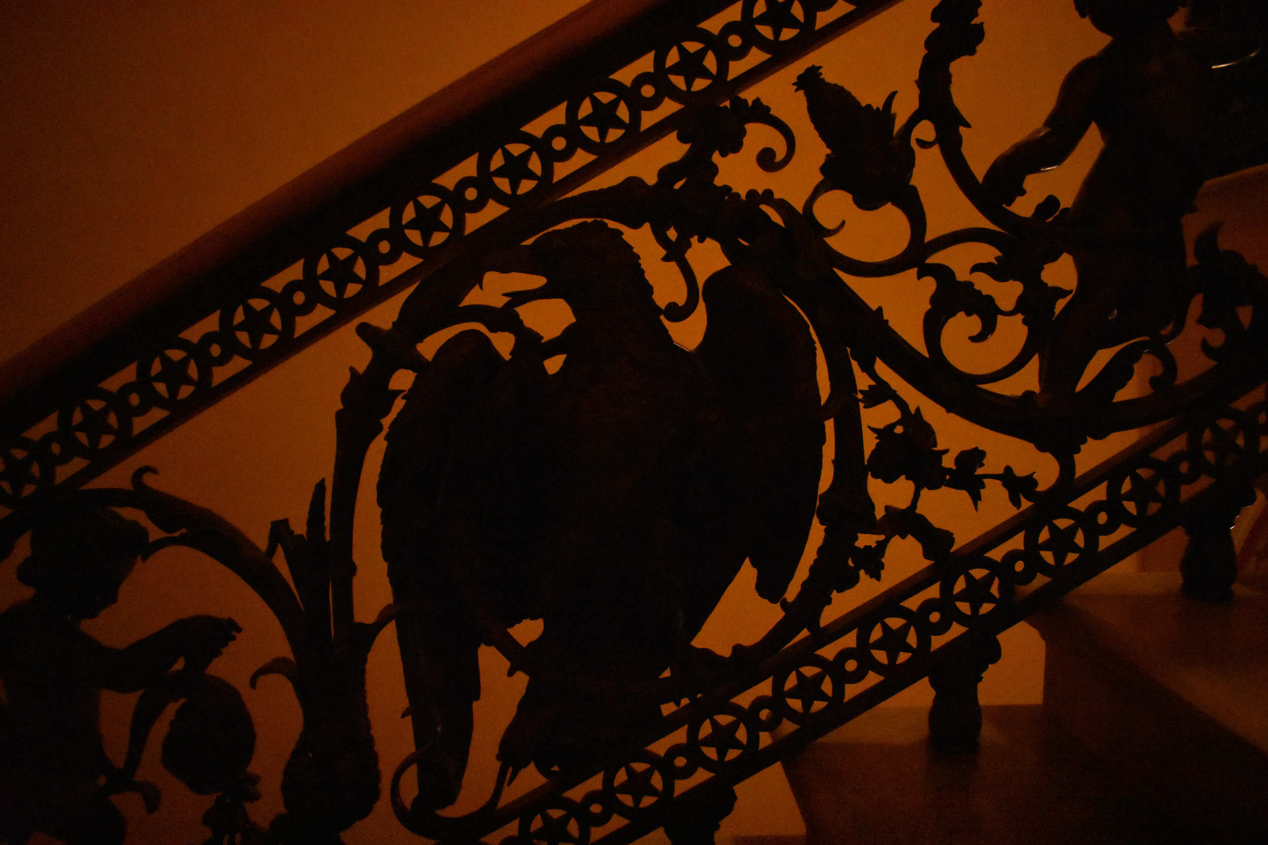 An intricate railing, on a staircase leading up to the second floor of the Senate side of the U.S. Capitol in Washington, is pictured Thursday, Jan. 25, 2018. The eagle, at center, sits between two cherubs. (Lindsey Leake/American University)