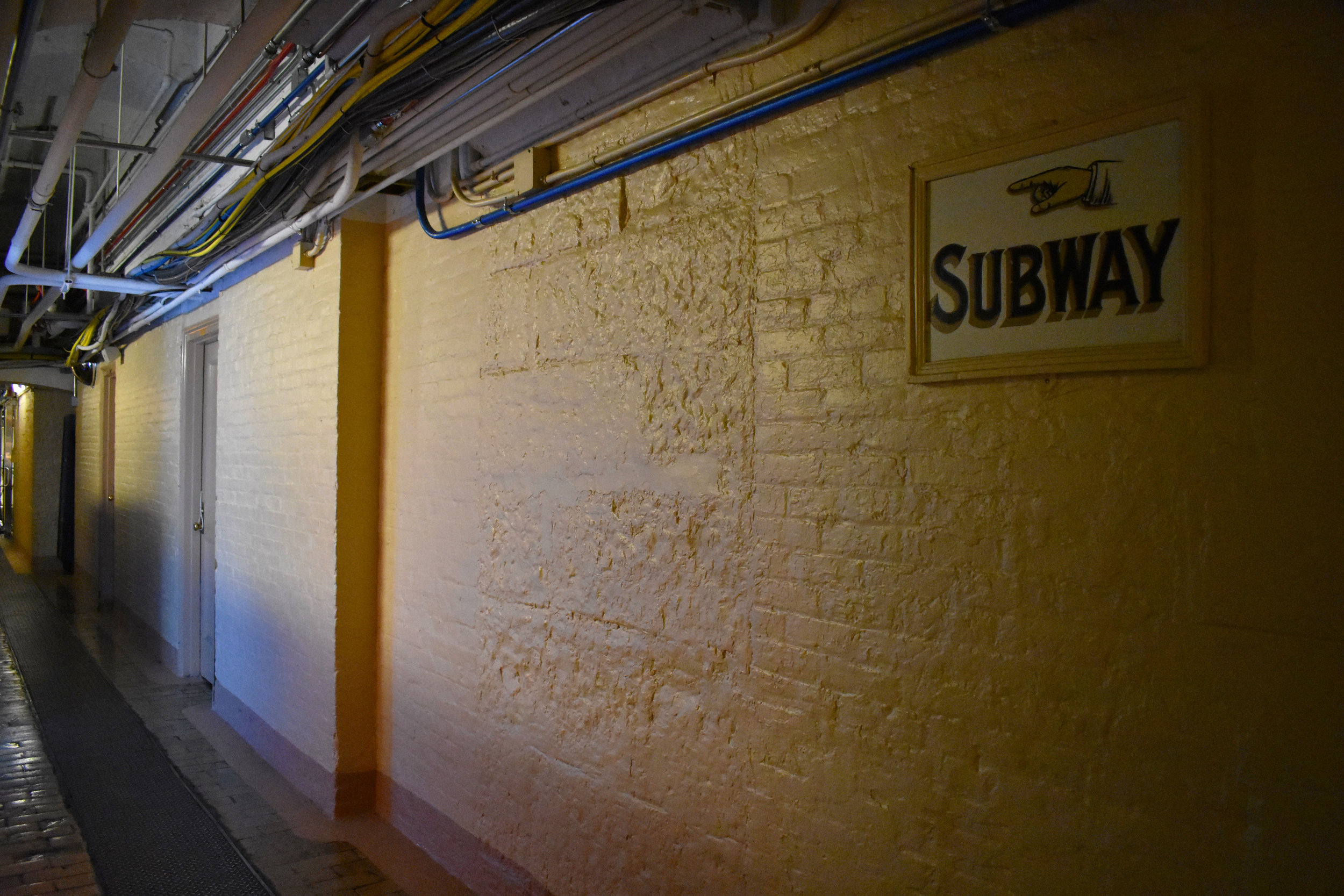 A sign points toward the Senate subway system in the basement of the U.S. Capitol in Washington, Thursday, Jan. 25, 2018. (Lindsey Leake/American University)