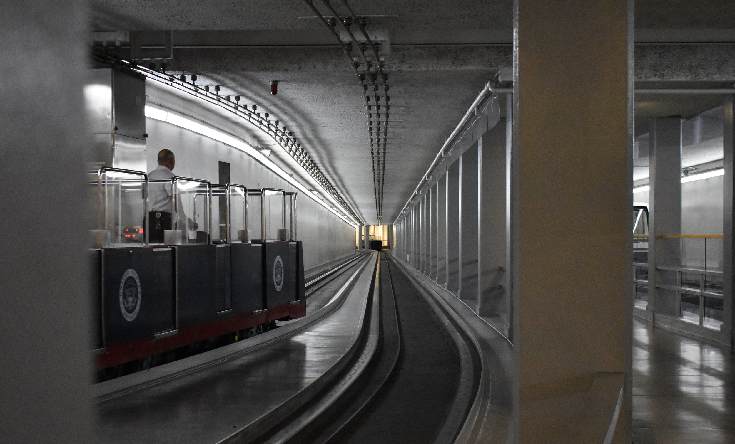 A man operates a train on the Senate subway system in the basement of the U.S. Capitol in Washington, Thursday, Jan. 25, 2018. (Lindsey Leake/American University)