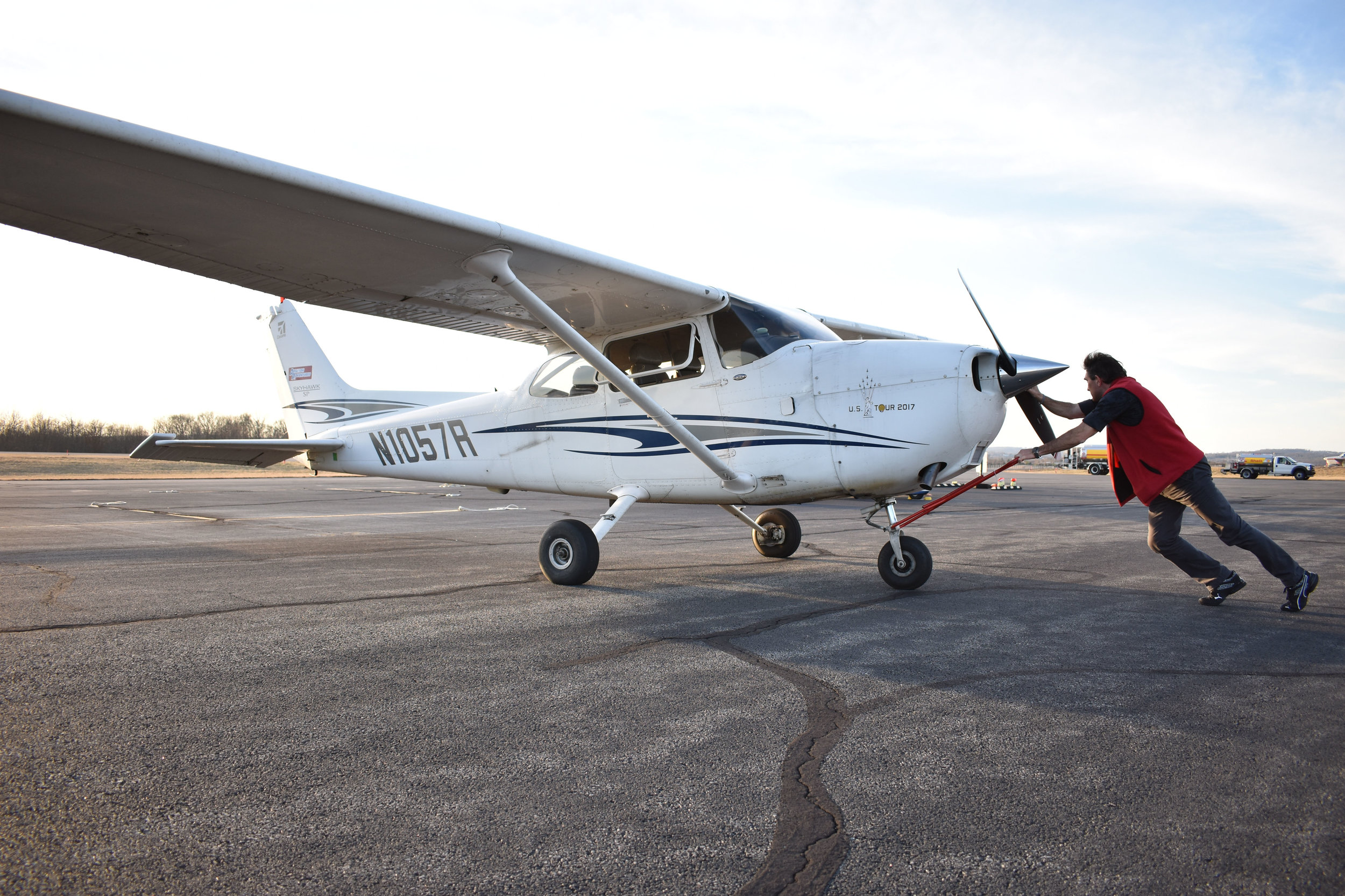 Raymond de Haan, assistant chief flight instructor at Aviation Adventures in Leesburg, Va., pushes a 2005 Cessna Skyhawk 172SP G1000 back into its parking spot at Leesburg Executive Airport (JYO), Tuesday, Feb. 20, 2018. (Lindsey Leake/American University)