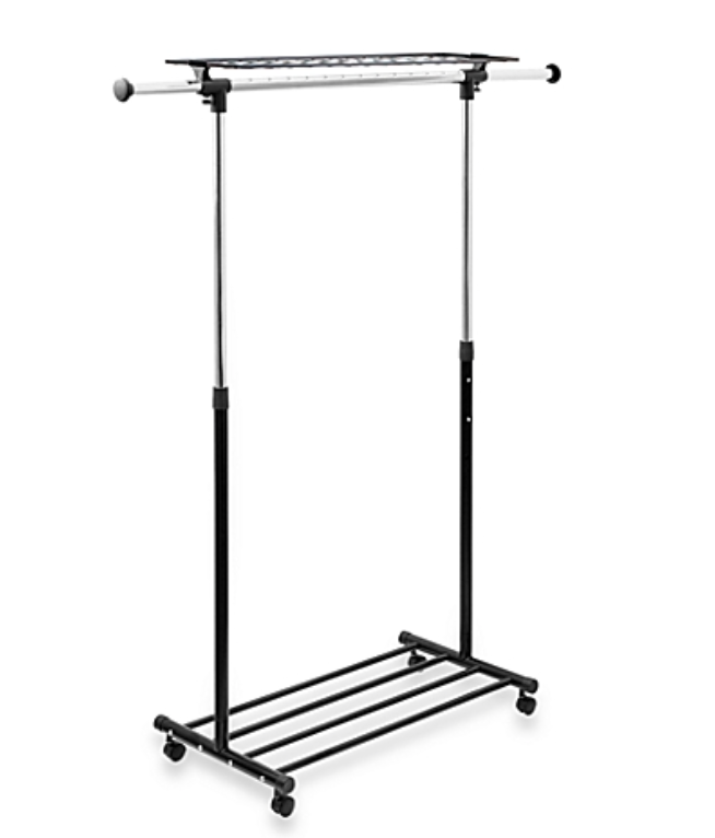 Small living space.  Black and Silver clothing rack.