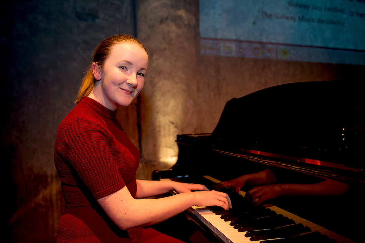 GMC Launch girl on piano.JPG