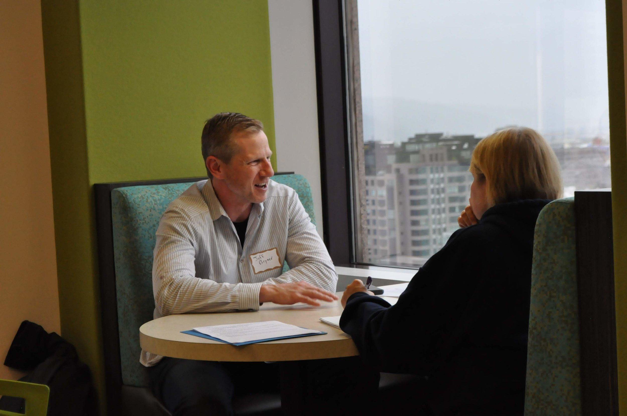 get hired up meeting between two people.jpg
