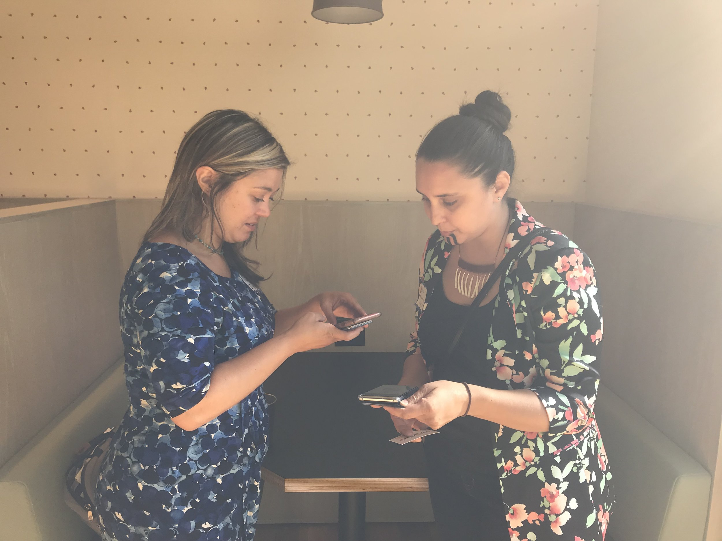 Women exchanging contact info.JPG