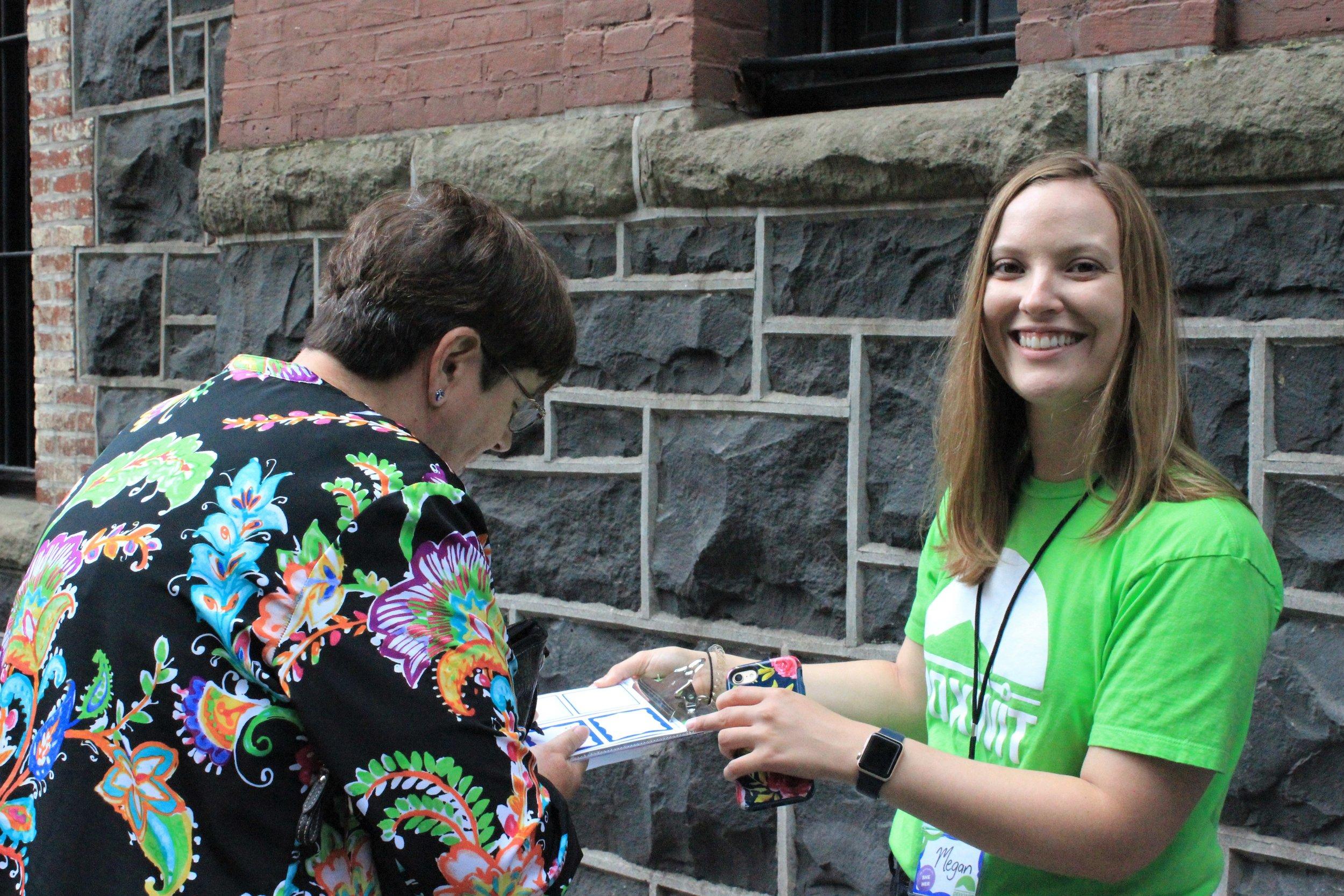 Volunteer checking in attendee.jpg