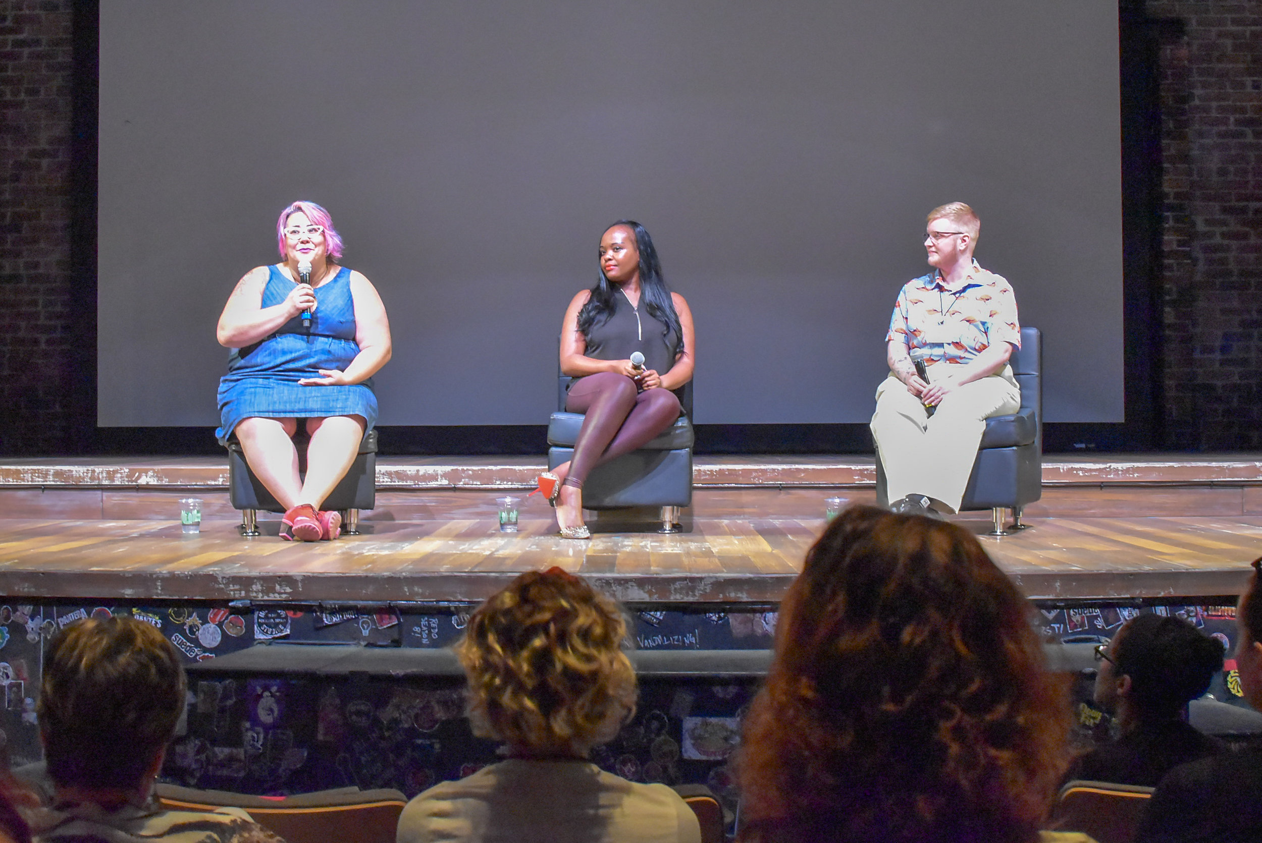 Tara Robertson speaking on stage with Esther John (right) and Sage Sharp (far right)JPG.JPG