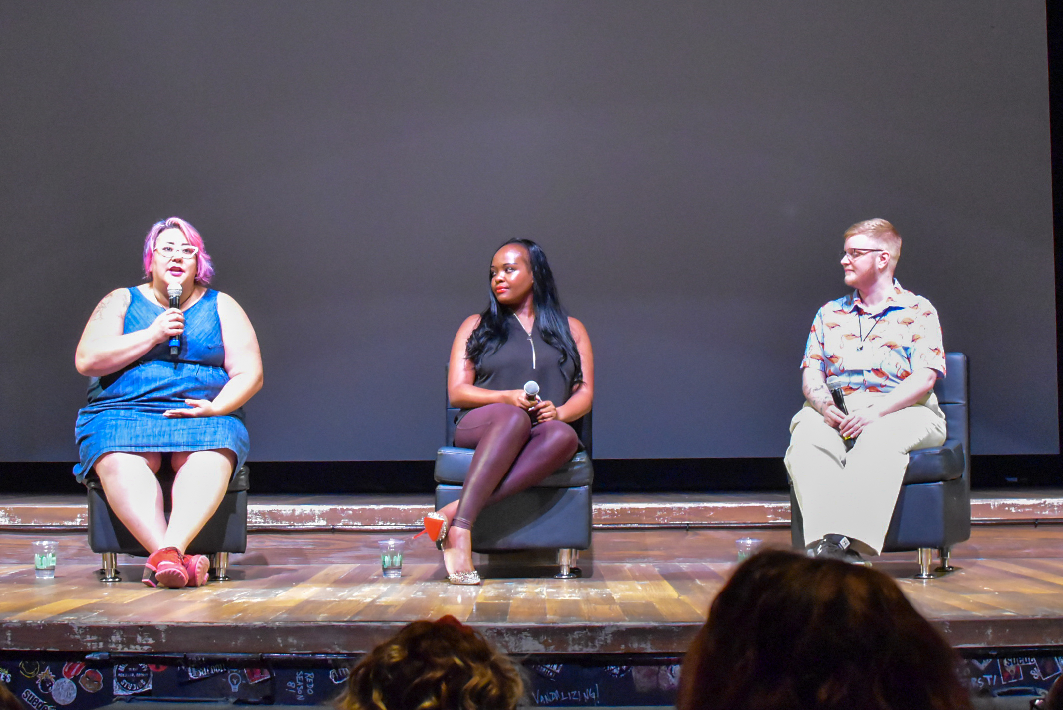 Tara Robertson speaking on stage with Esther John (right) and Sage Sharp (far right).JPG