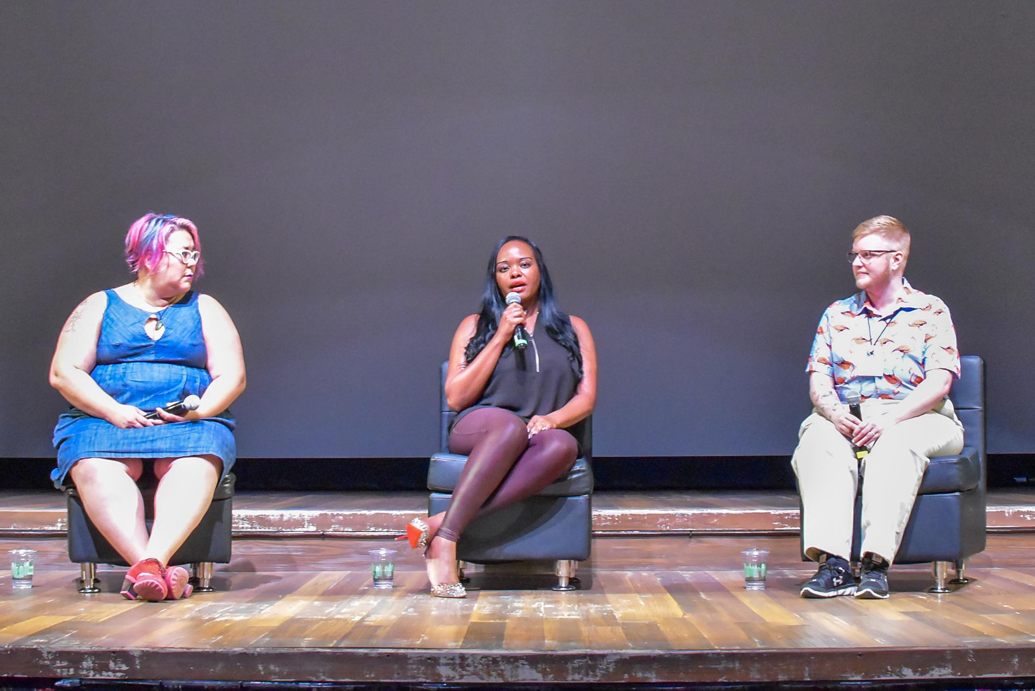 Speaker Esther John on stage with Tara Robertson (left) and Sage Sharp (left)  (1).JPG
