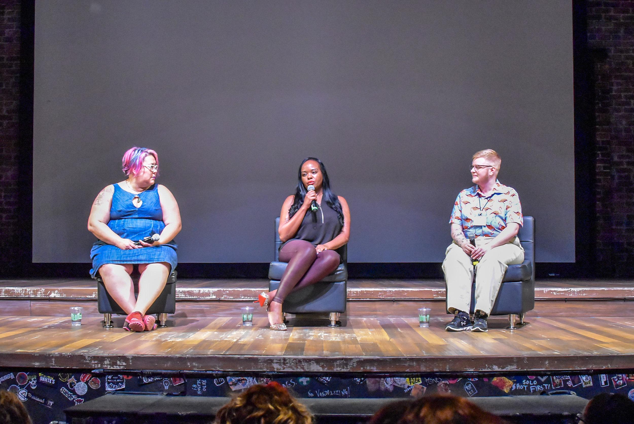Speaker Esther John on stage with Tara Robertson (left) and Sage Sharp (left) .JPG