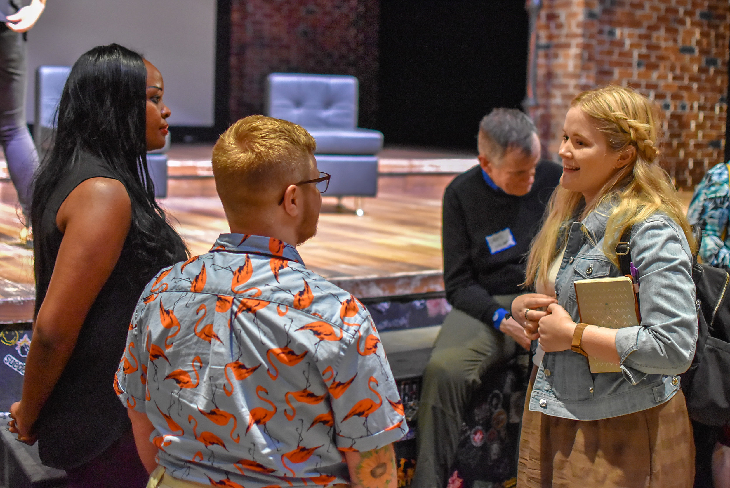 Sage-Sharp and Esther-John talking with attendee.JPG