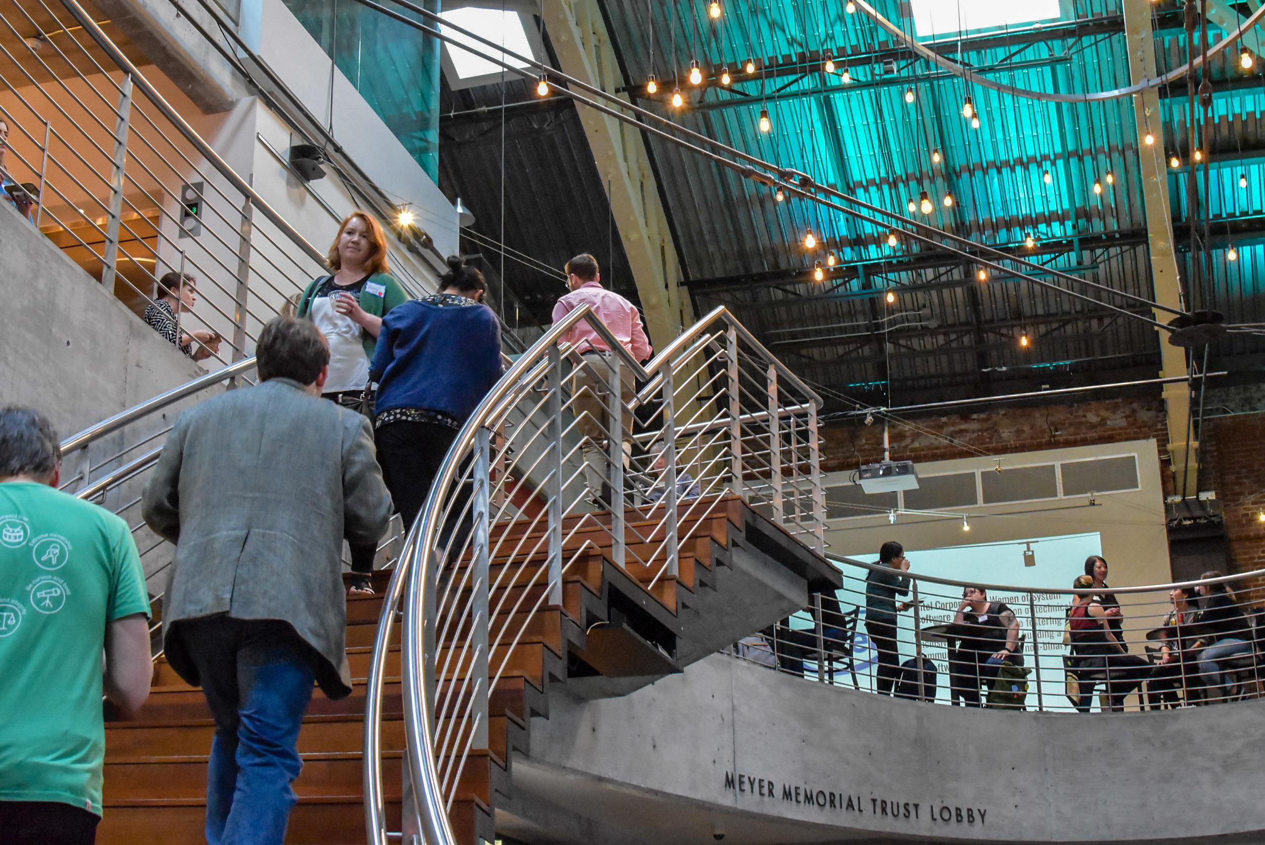 People walking up and down venue stairs.JPG