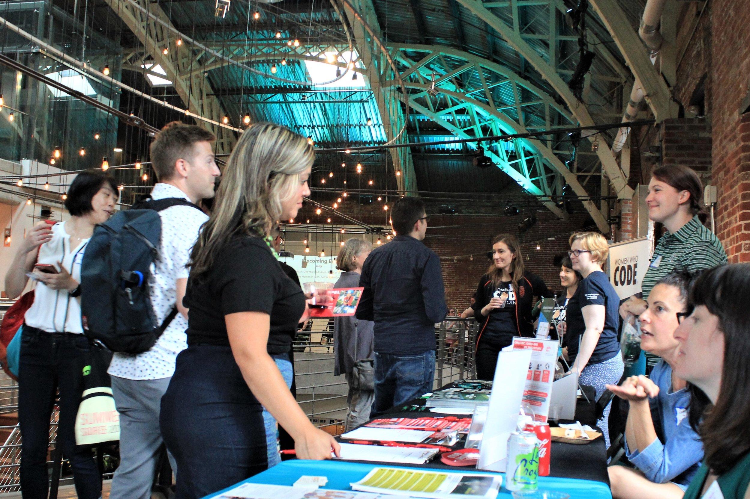 People talking at sponsor table (2).jpg