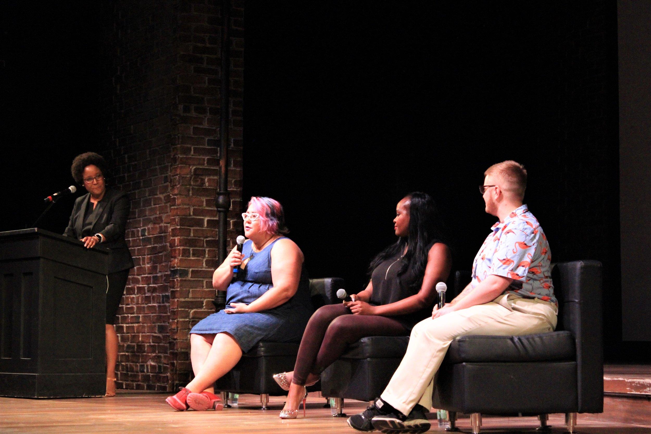 Panel speakers on stage.jpg