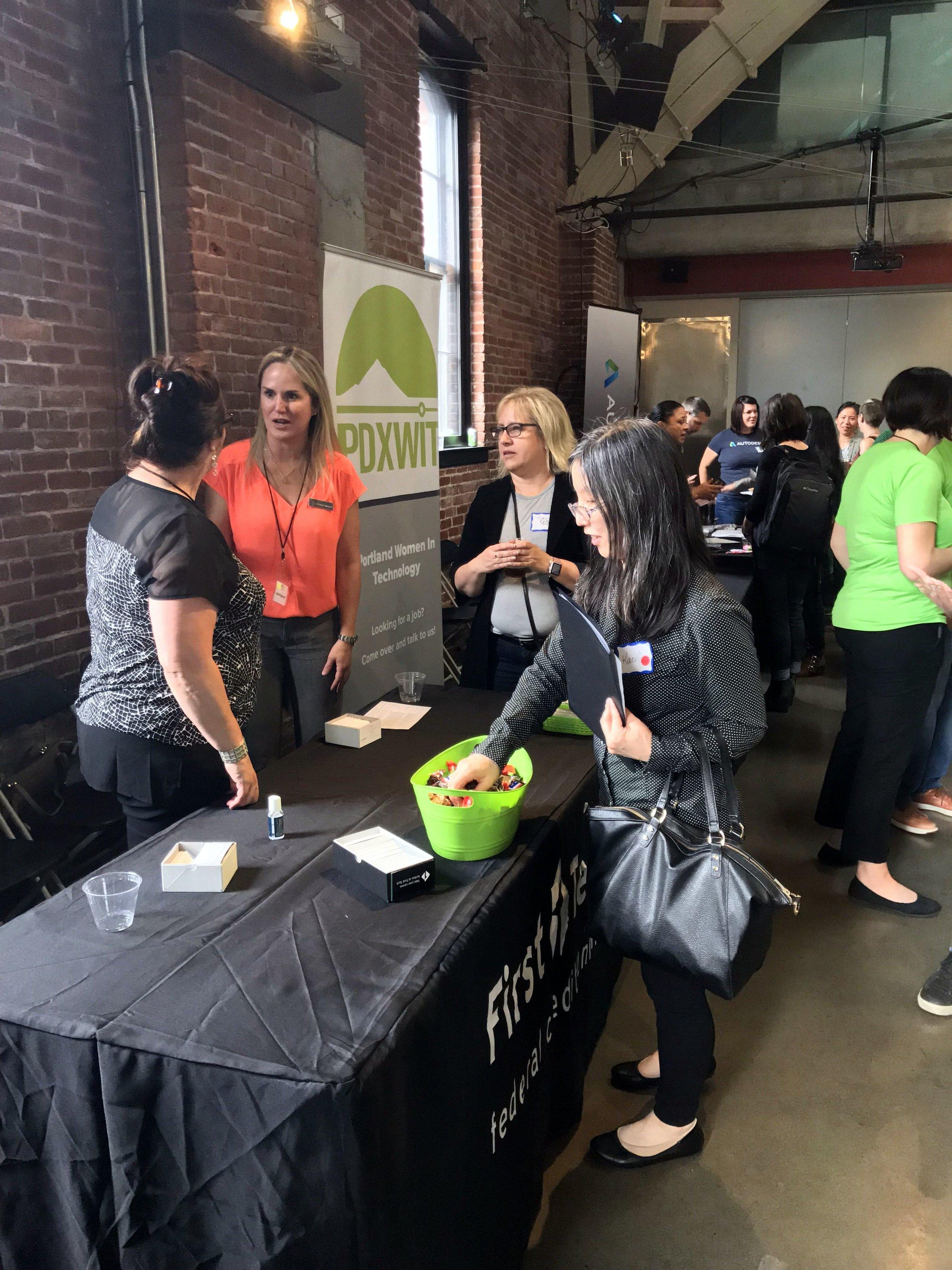 First Tech folks talking to attendees.jpg