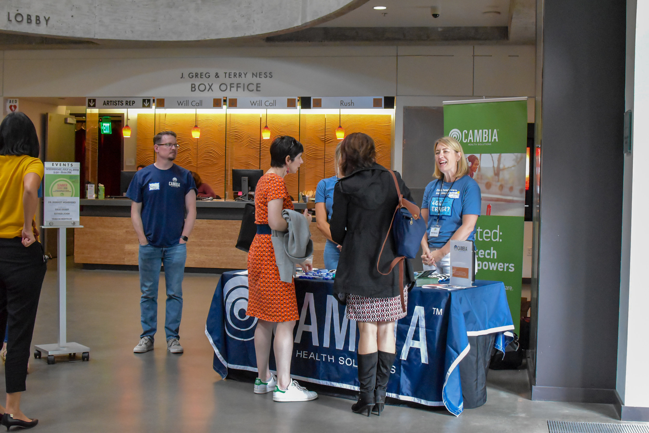 Attendees talk with sponsor Cambia.JPG