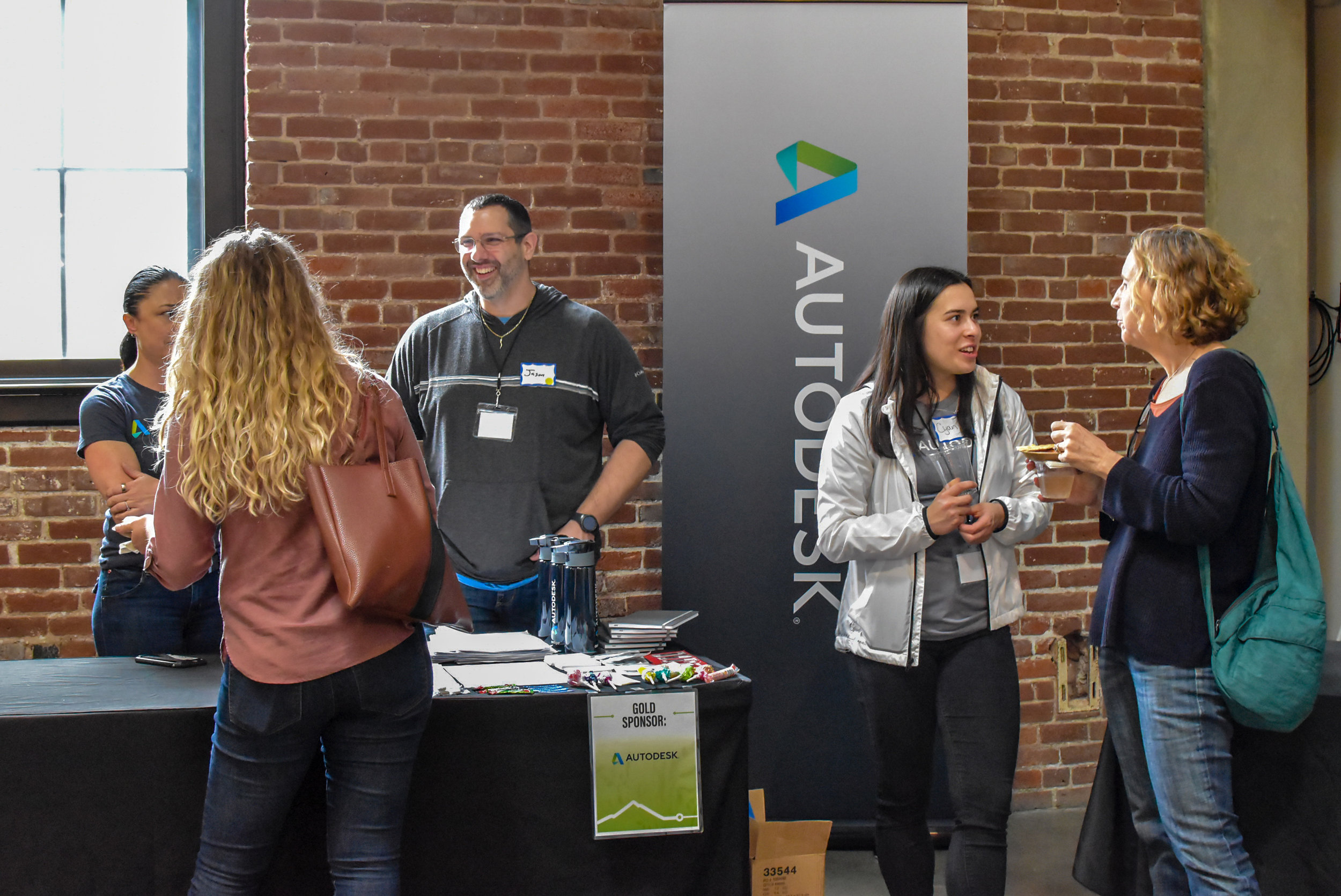Attendees chatting with sponsor Autodesk.JPG