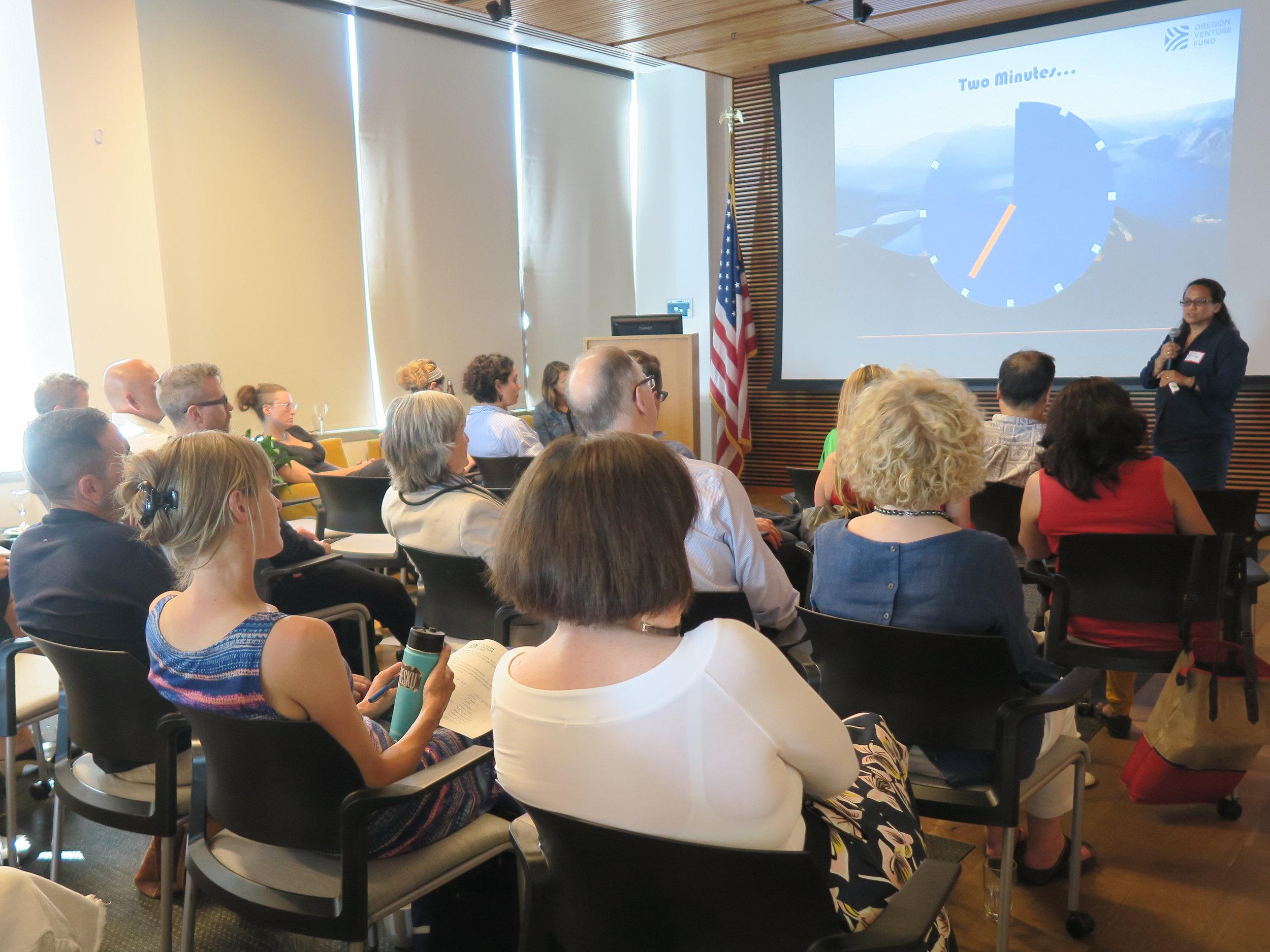 Speaker talking to audience.jpg