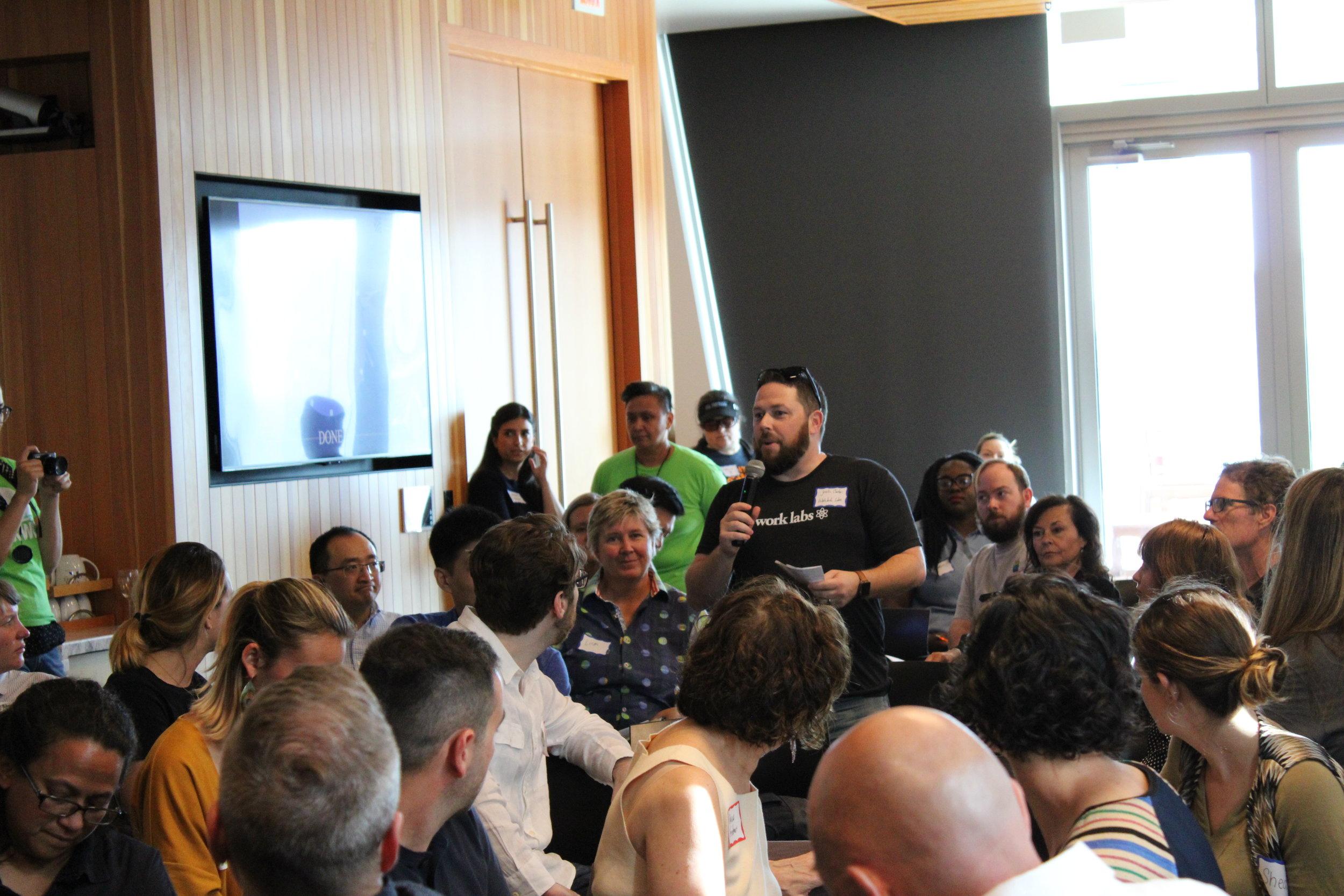 Audience member speaking into mic.JPG
