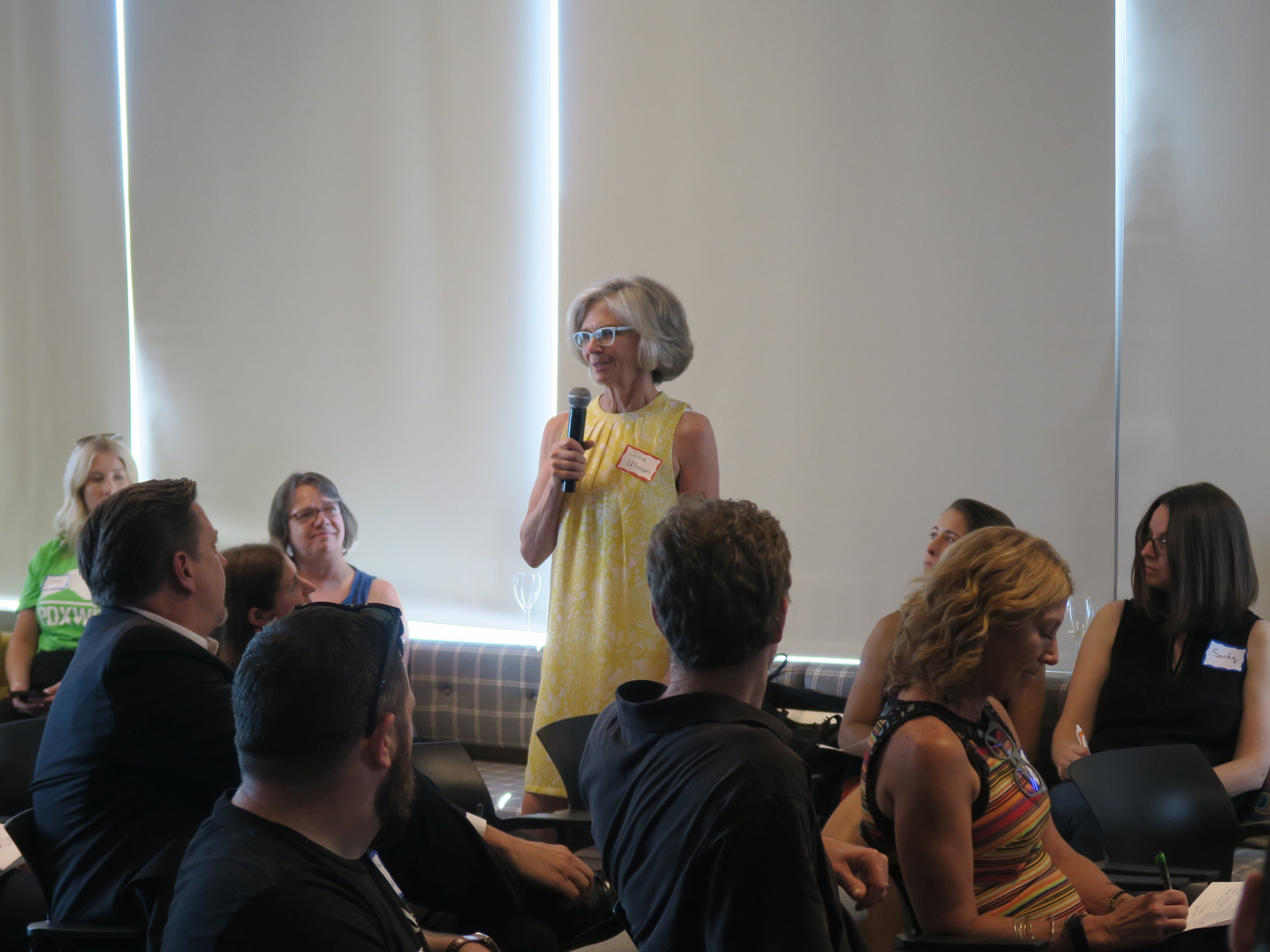 Attendee speaking to audience.jpg