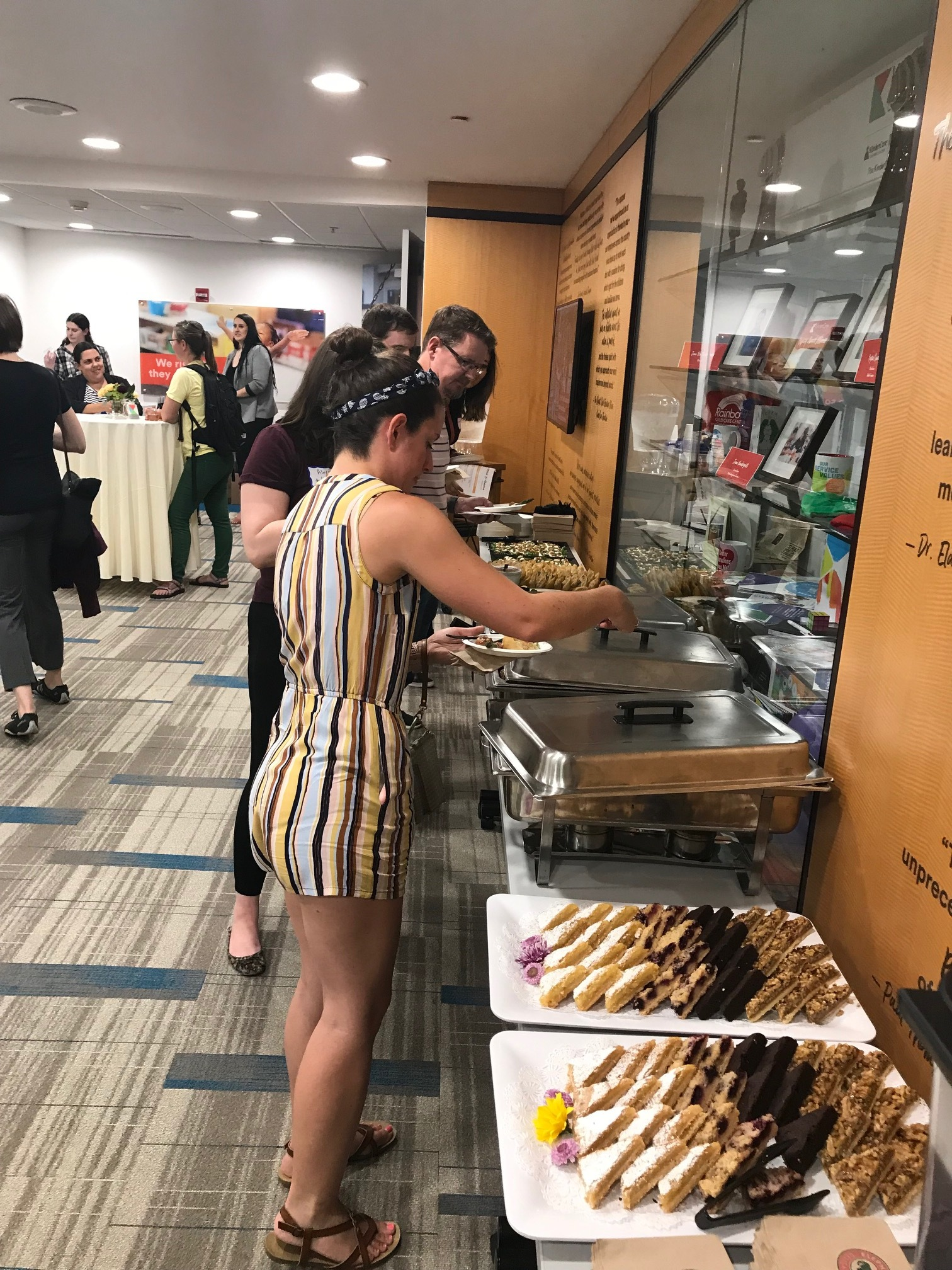 Attendee serving themselves food.jpg