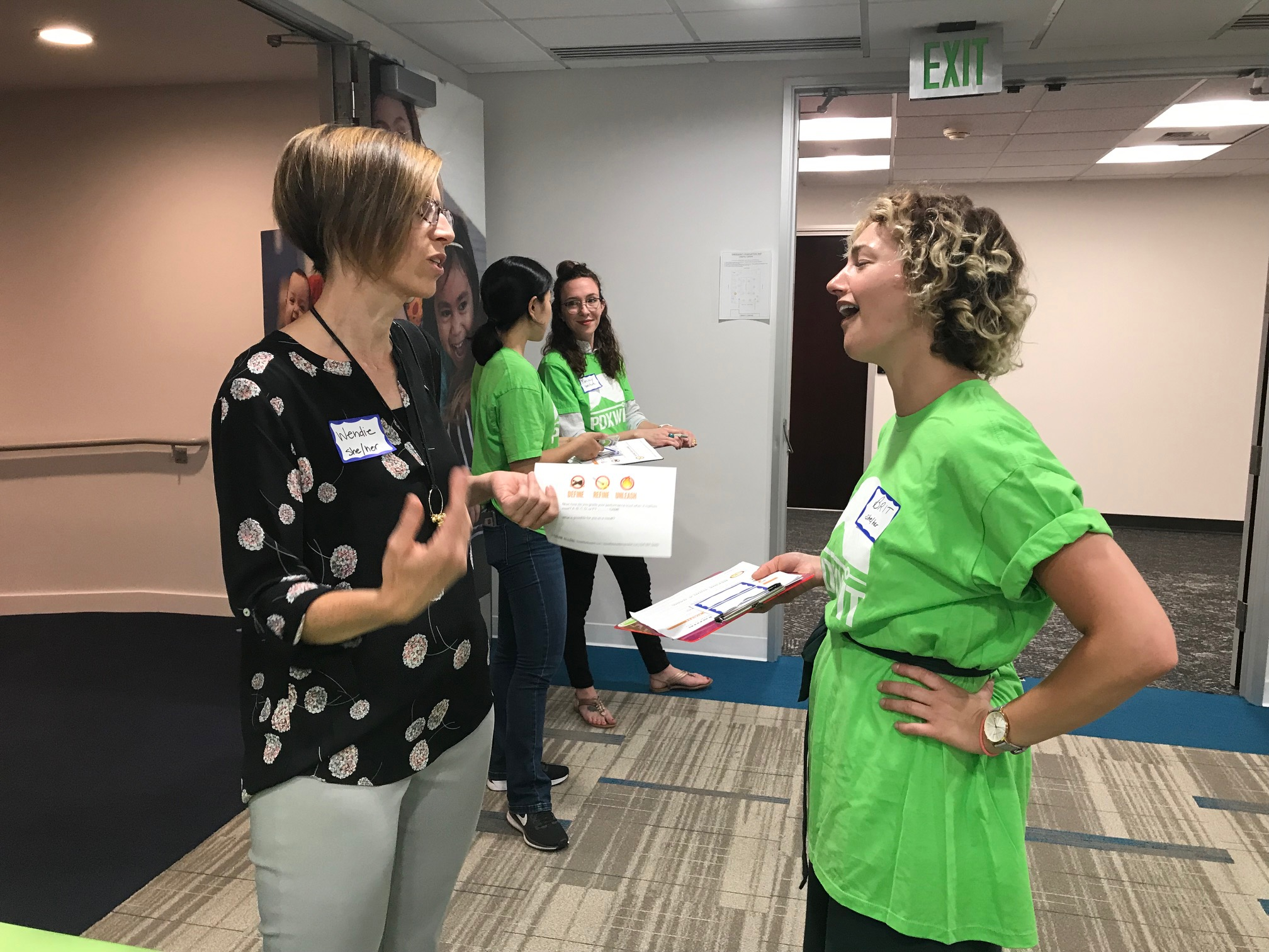 Attendee chatting with volunteer.jpg