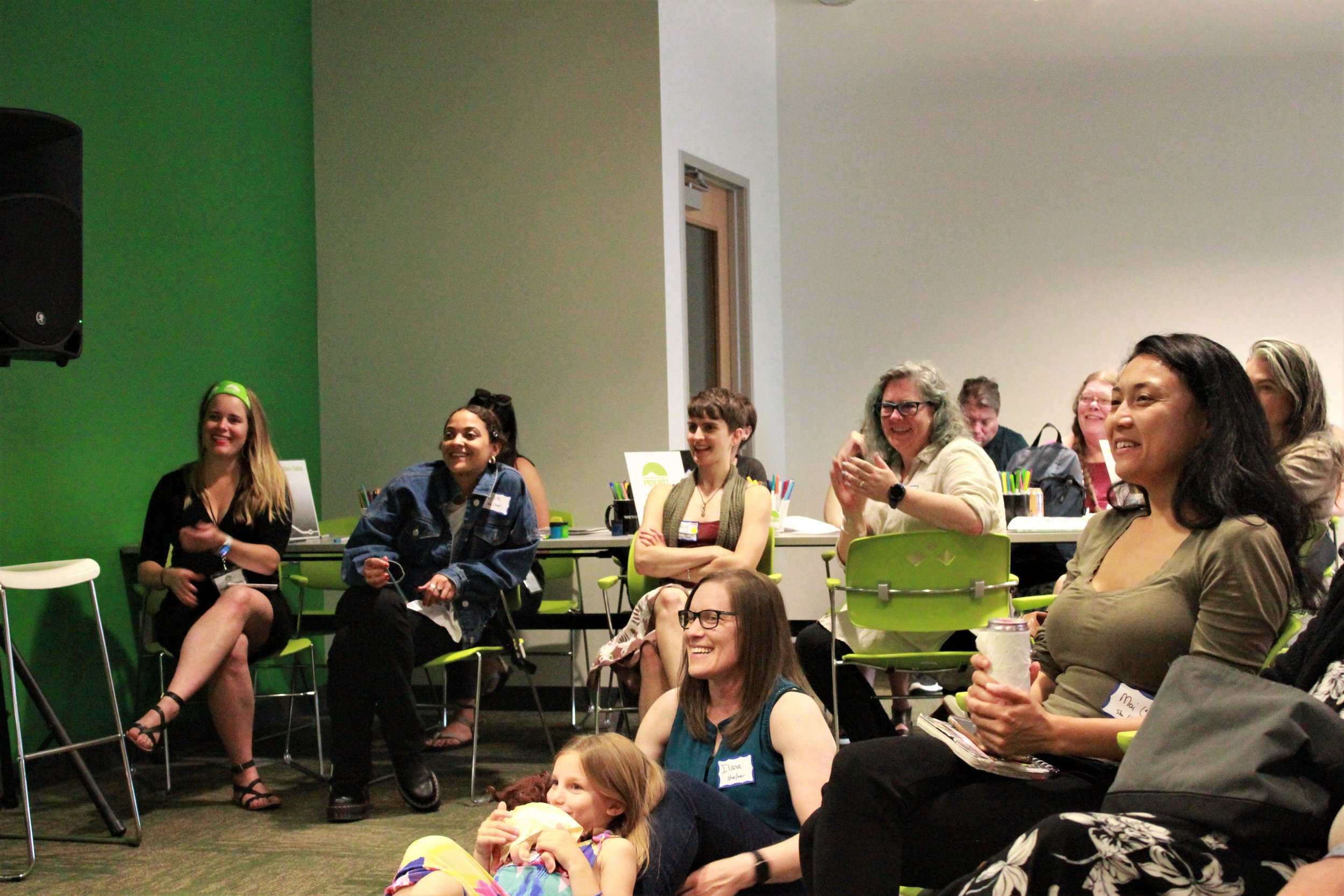 Audience listening and smiling.jpg