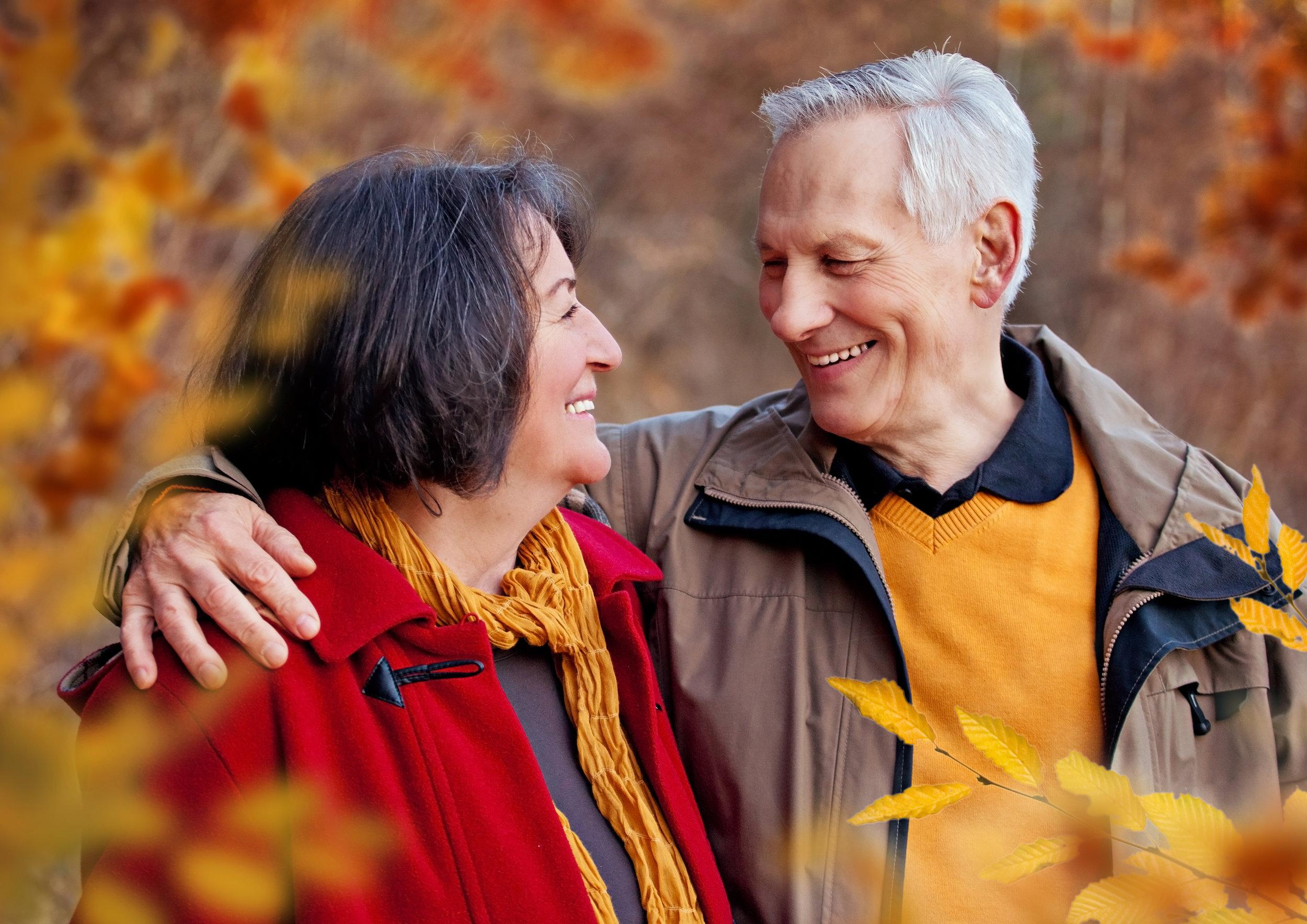 bigstock-seniors-walking-in-autumn-fore-50057432.jpg