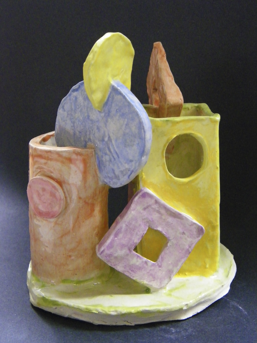 Students used shapes and color to describe family members and their relationship to each other. They assembled the individual pieces with attention to shape and form, learning how to score and slip while they built their ceramic forms. This was prompted by efforts to understand how a non-figurative sculpture can have meaning to the maker.