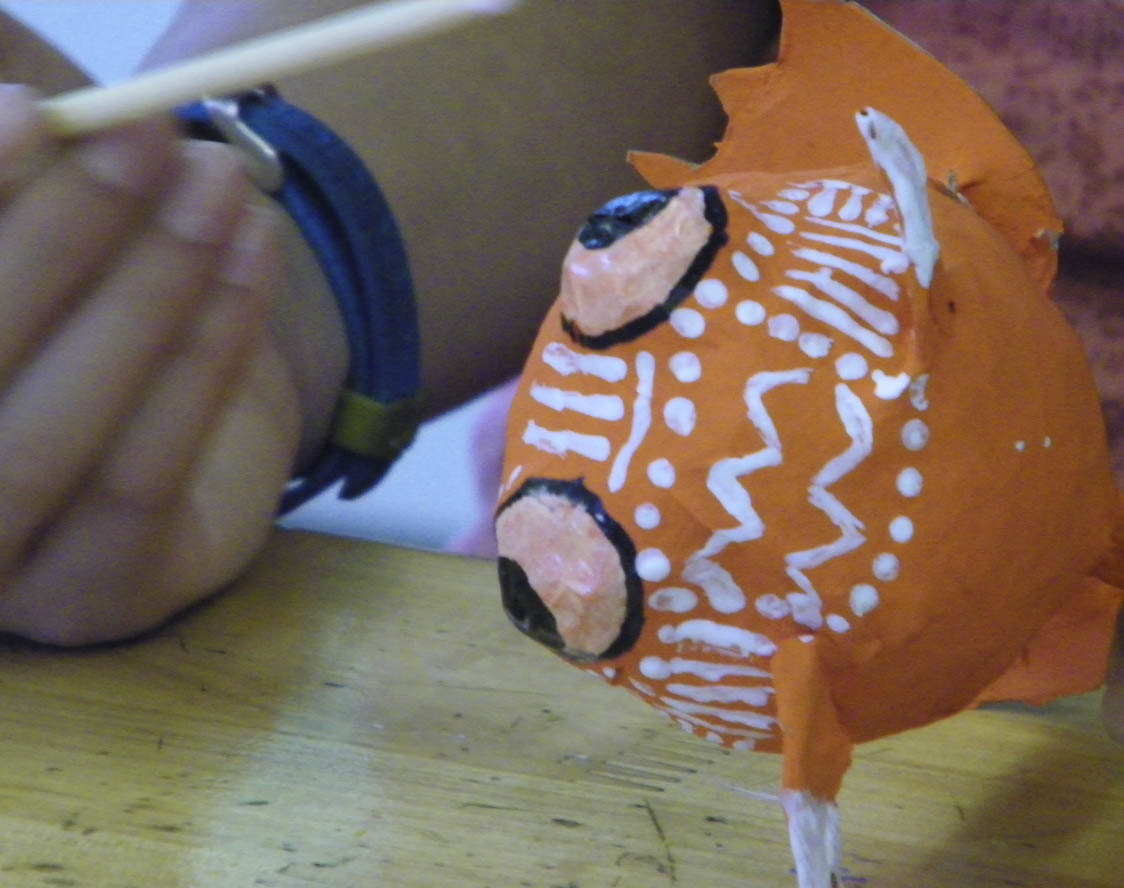 Students sculpted and painted fantastical paper-maché creatures based on the tradition of Oaxacan-Mexican alebrijes.