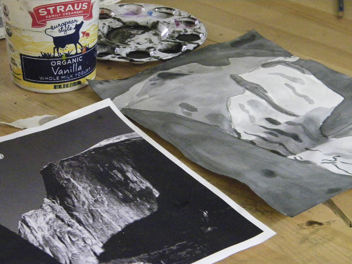 Students learn how value plays a role in atmospheric perspective with washes of India Ink.