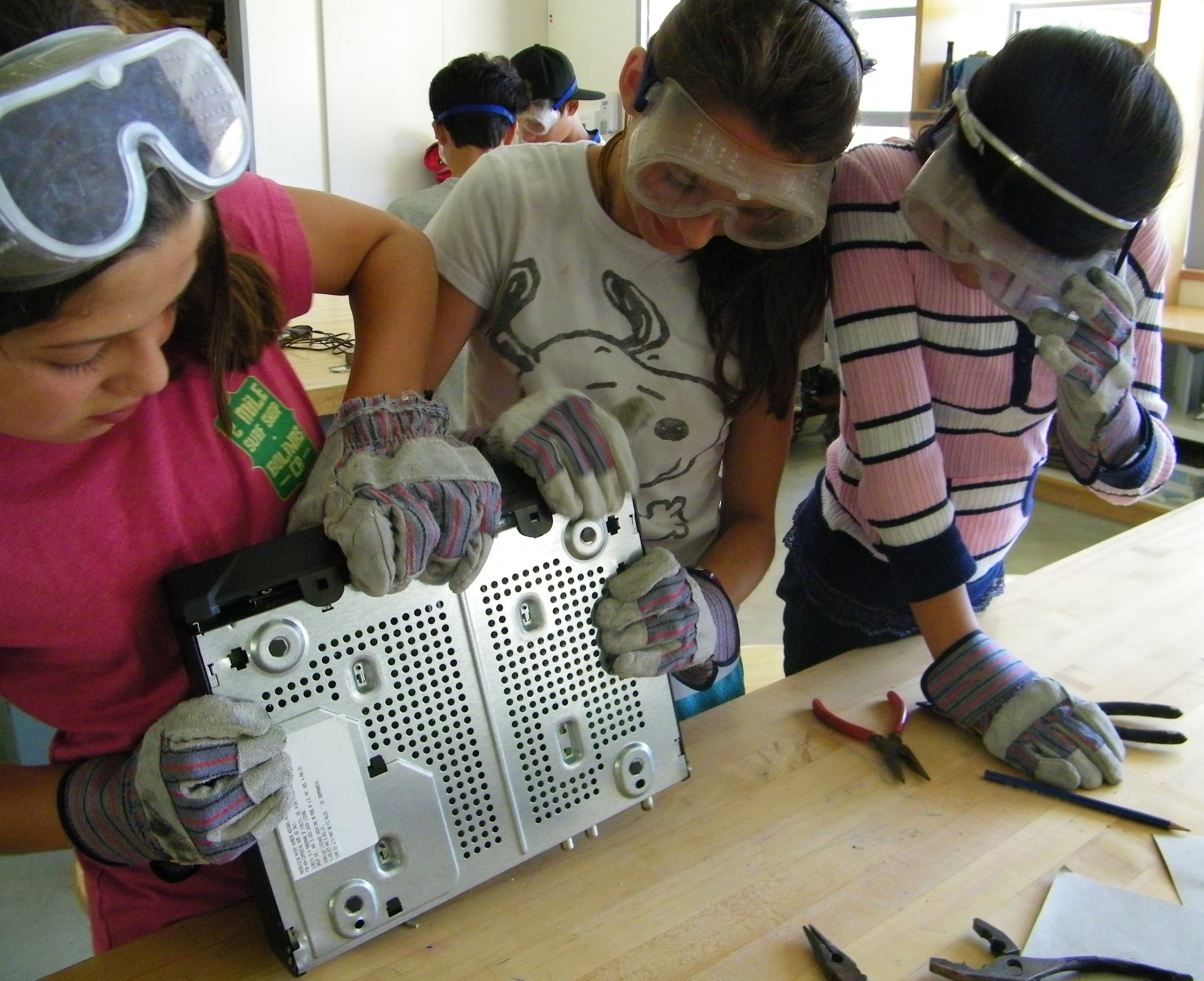Students had no fear in taking apart small machines that were used as a starting point for a contour drawings and recycled parts sculptures.
