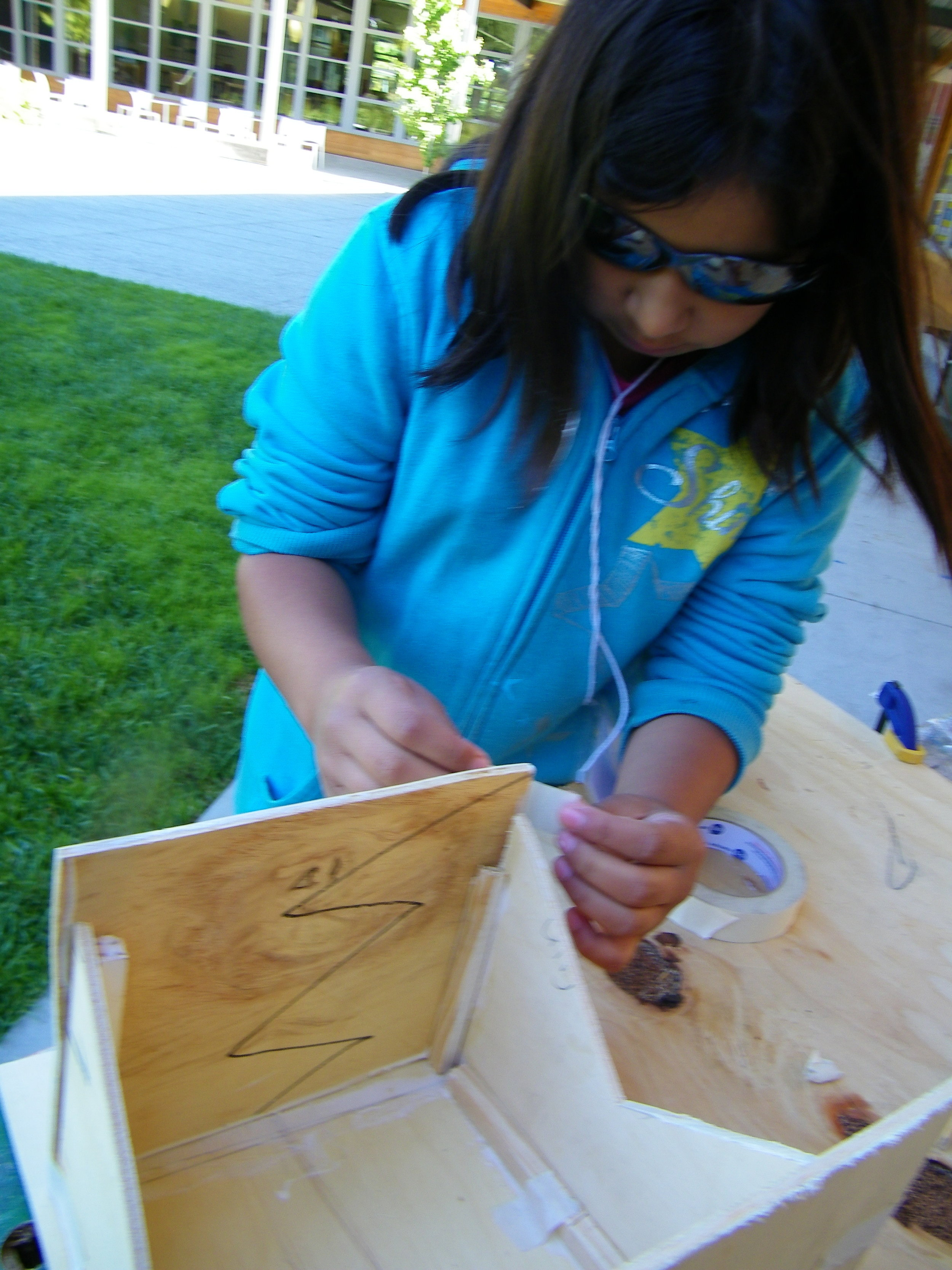One student was determined to build a birdhouse that would bring many species to her garden.