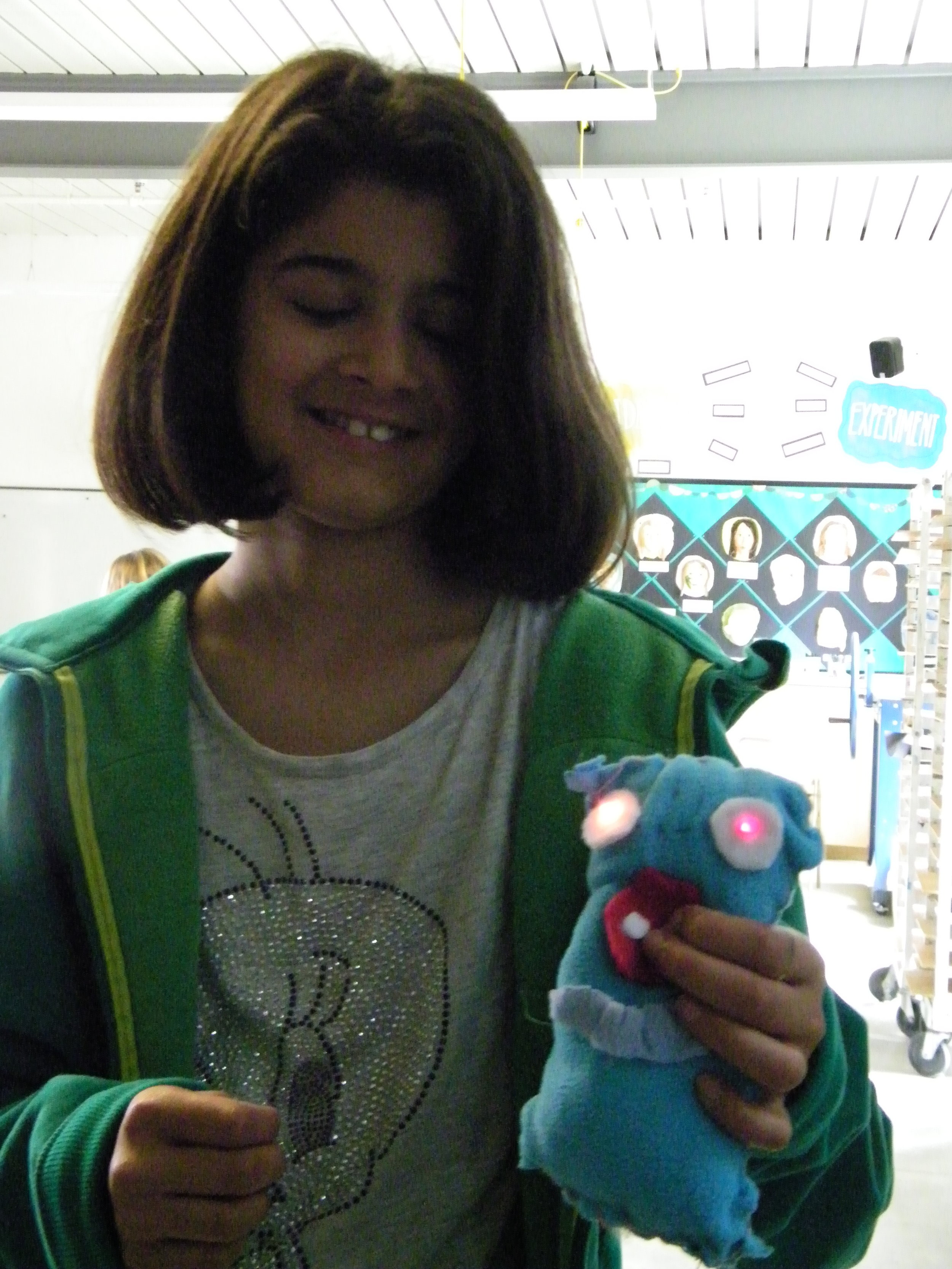 During a recess art club, students learn how to make soft-circuit plushies.