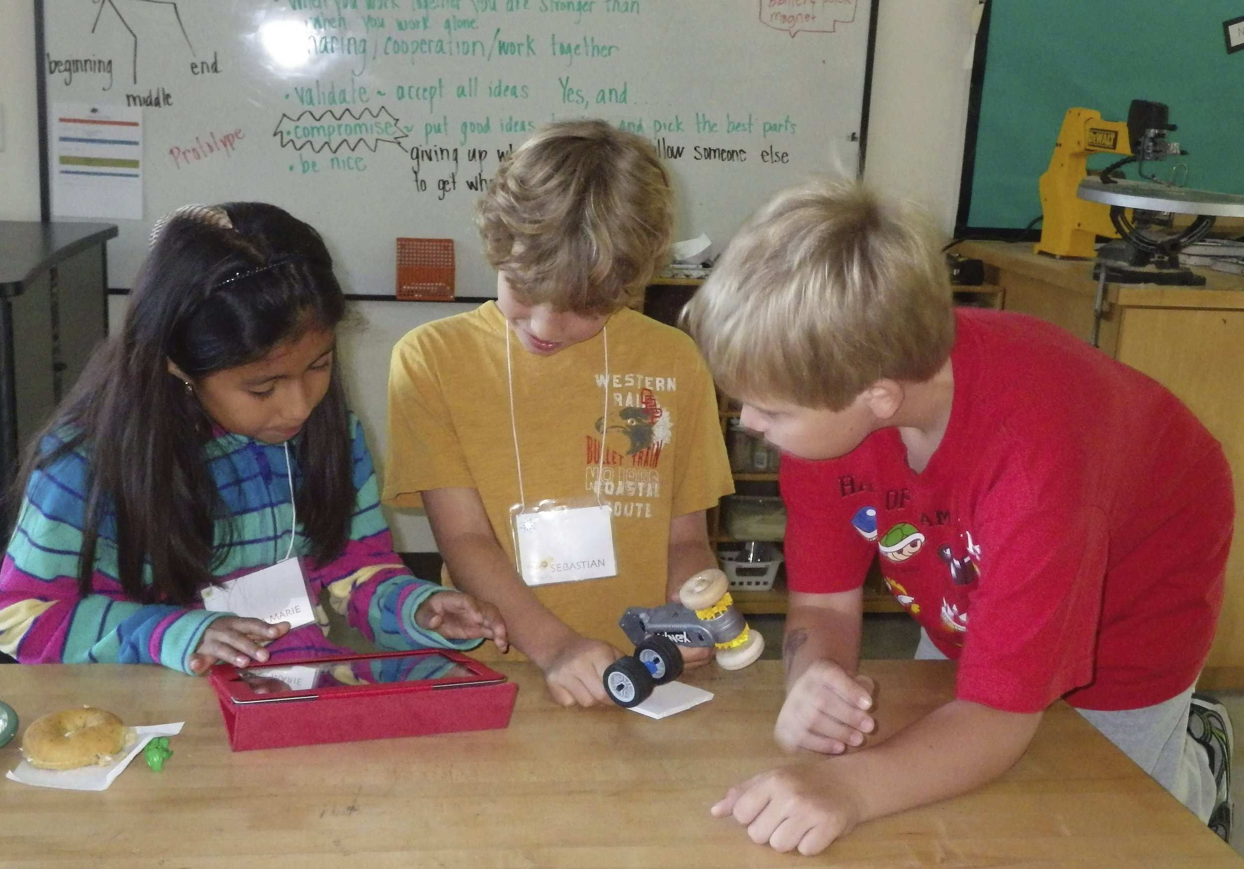 Students create presentations about their new classmates to share later with the whole class.