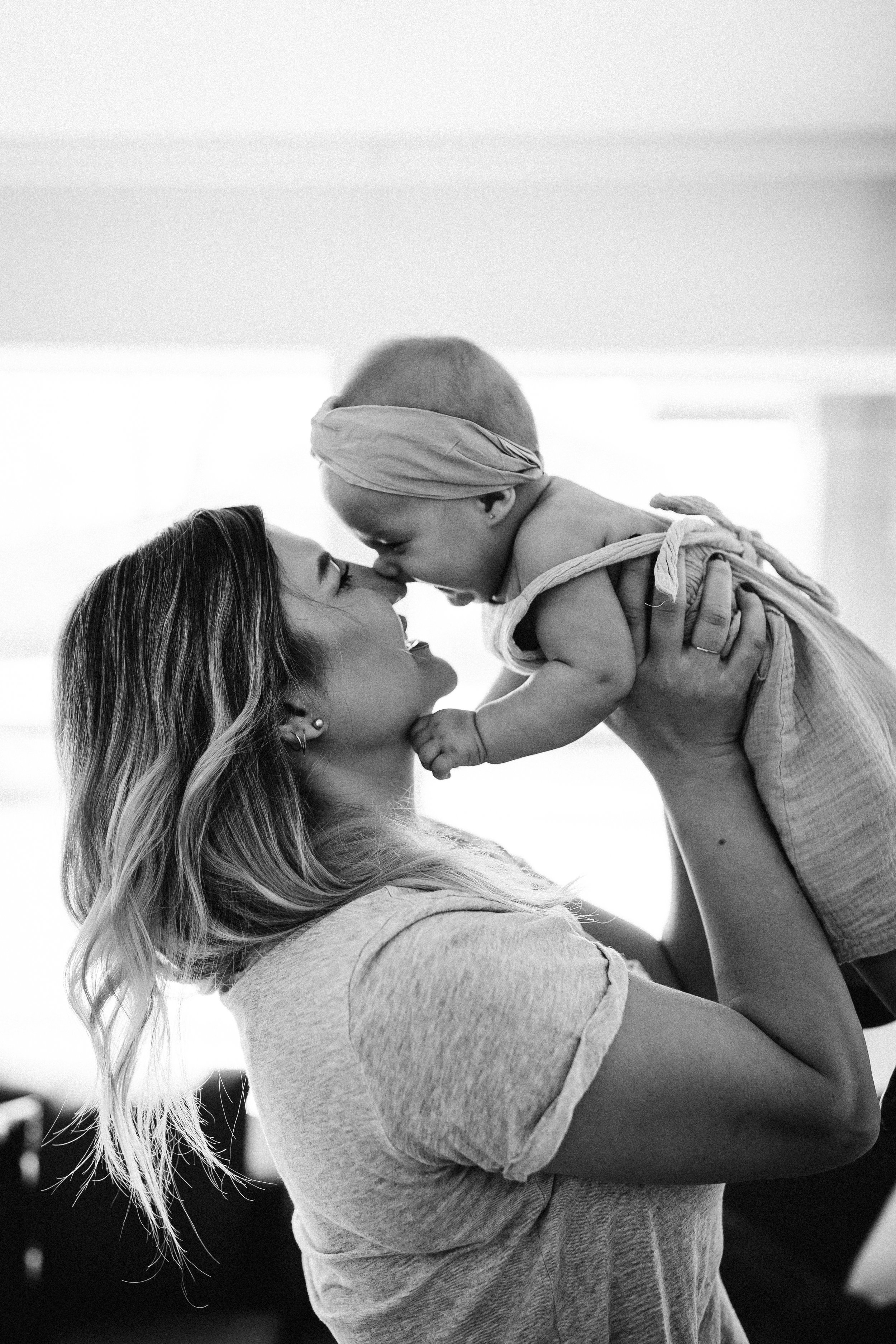 Classic photo of mother playing with baby.jpg