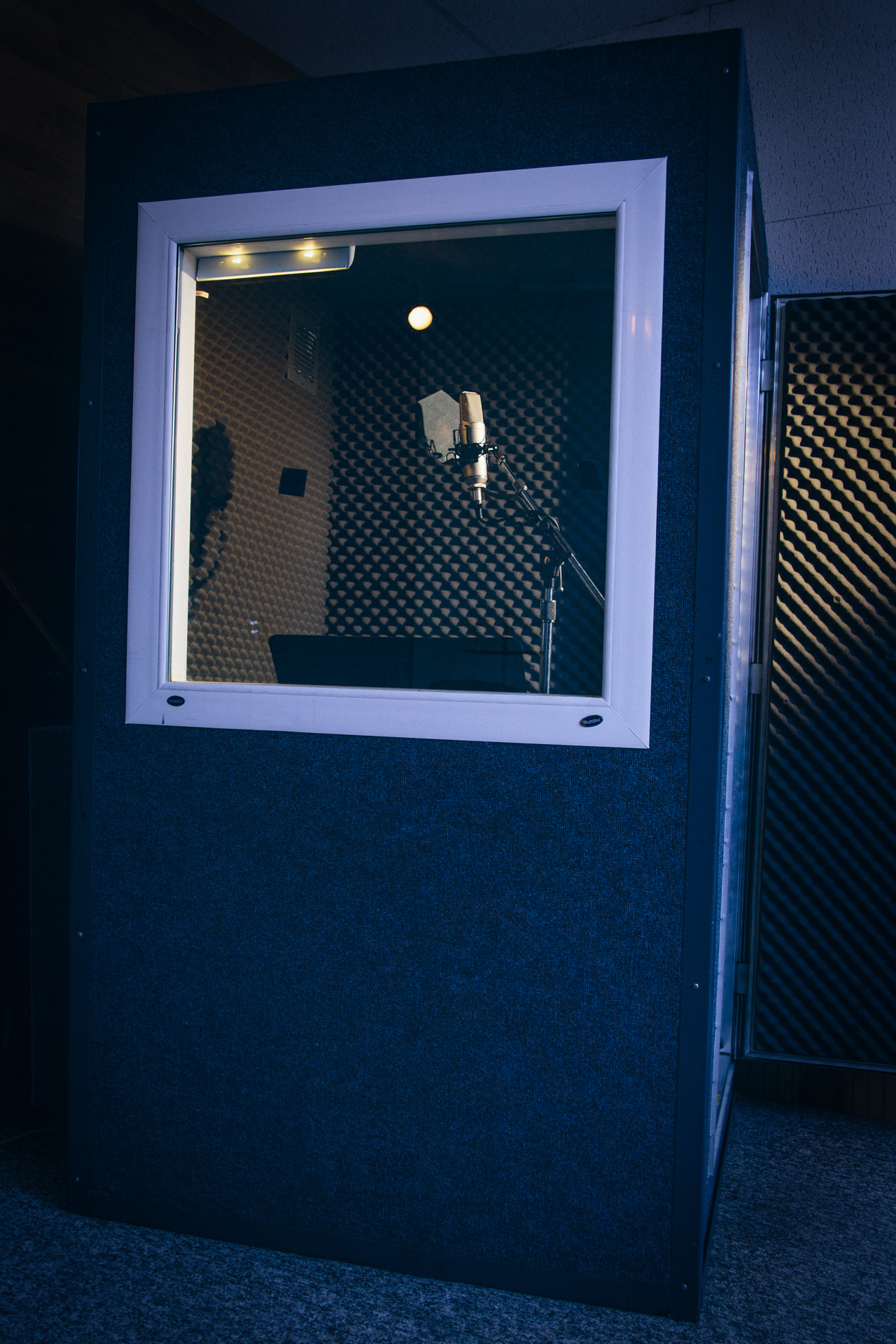 Our spacious vocal booth features plenty of room for you (and your instrument, if need be).