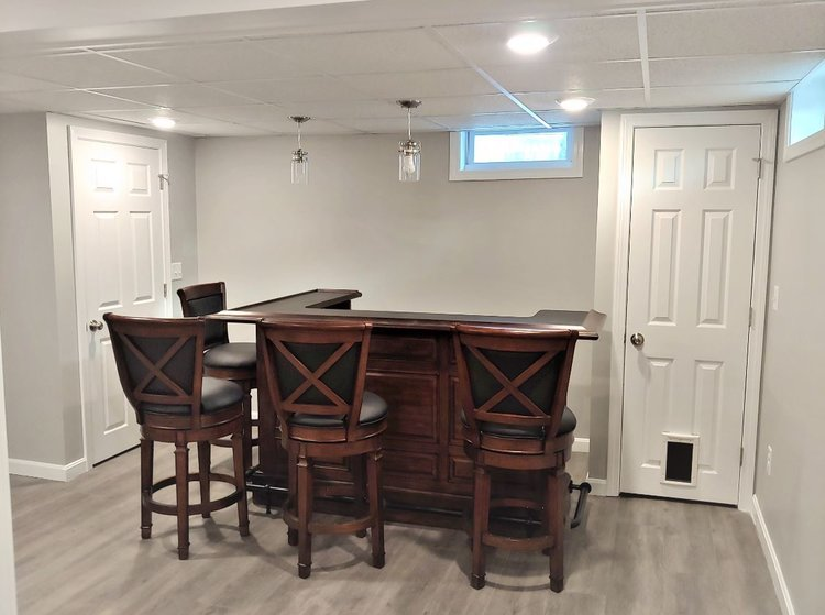 finished basement with a bar - webster massachusetts