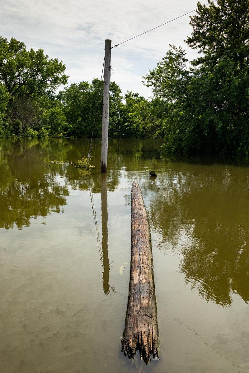 48_JennaCarliePhotography_June 5, 2019_West Alton Flood_Telephone Pole Down.jpg