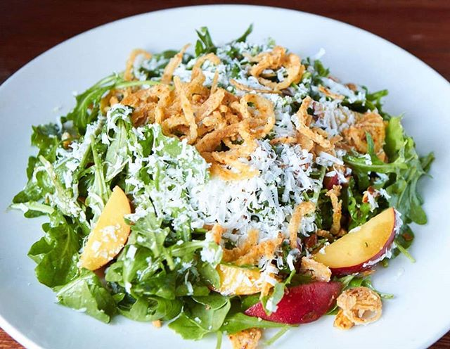 Arugula w/ Stone Fruit, Toasted Almonds, Crispy Shallots, Ricotta Salata and a Honey Balsamic Vinaigrette!