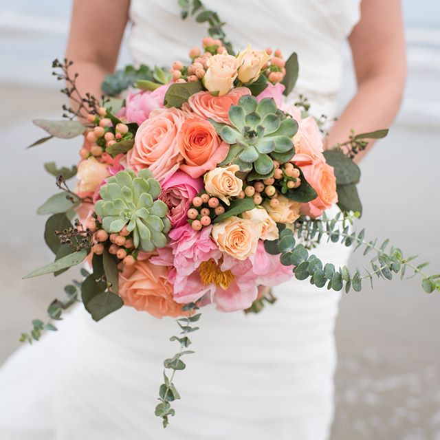 #tbt to this dreamy OBX beach wedding and the most special couple 💕I'm so glad that I got to be a part of your big day! Wish we could go back!! @sophrenchy @georgesayswhat 📸 by @natalieheimphotography  Florals, jewelry and decor by @wiredandflossin 🌸🌺 . . . #wedding #obx #obxwedding #custombridaljewelry #weddingflowers #handlettering #chalkboardsigns