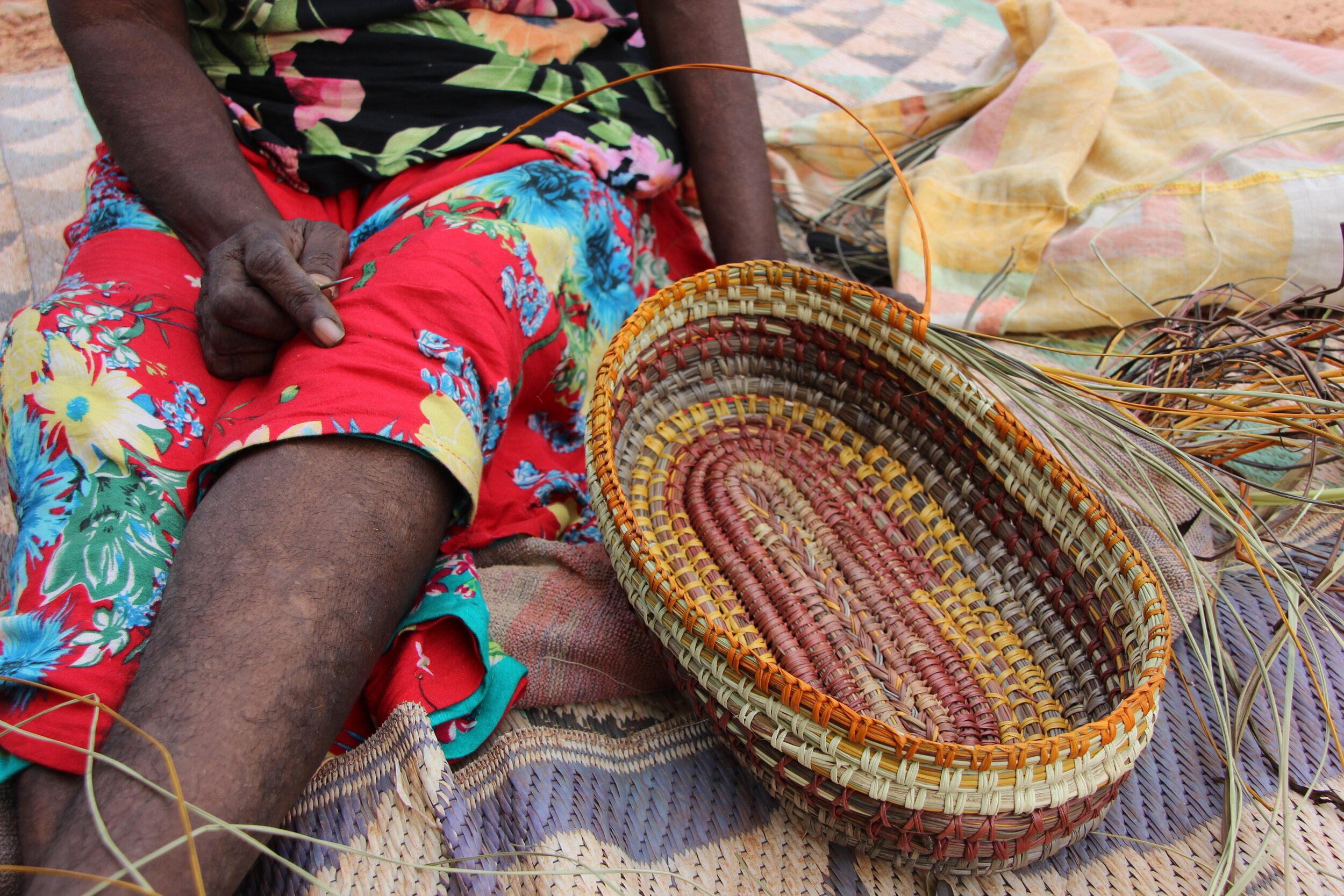 Weaving pandanus in New Sub, Maningrida. Image by Ingrid Johanson.
