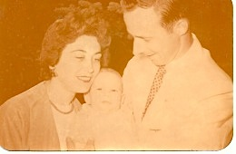 Ed and Frances Bahlke holding their adopted son, William P. Bahlke